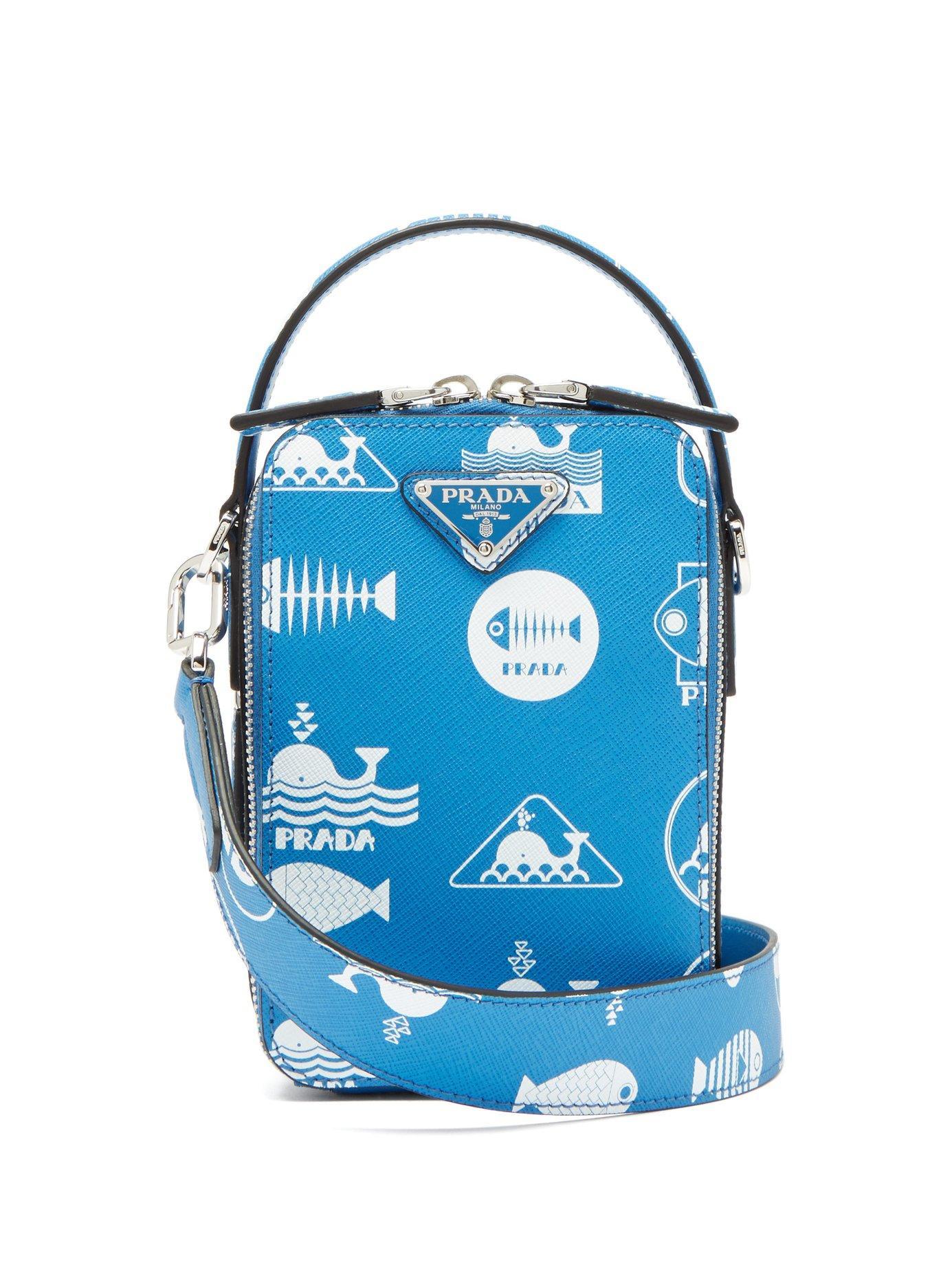cbb8de4bd8b5 Prada - Blue Whale Logo Print Saffiano Leather Cross Body Bag for Men - Lyst.  View fullscreen