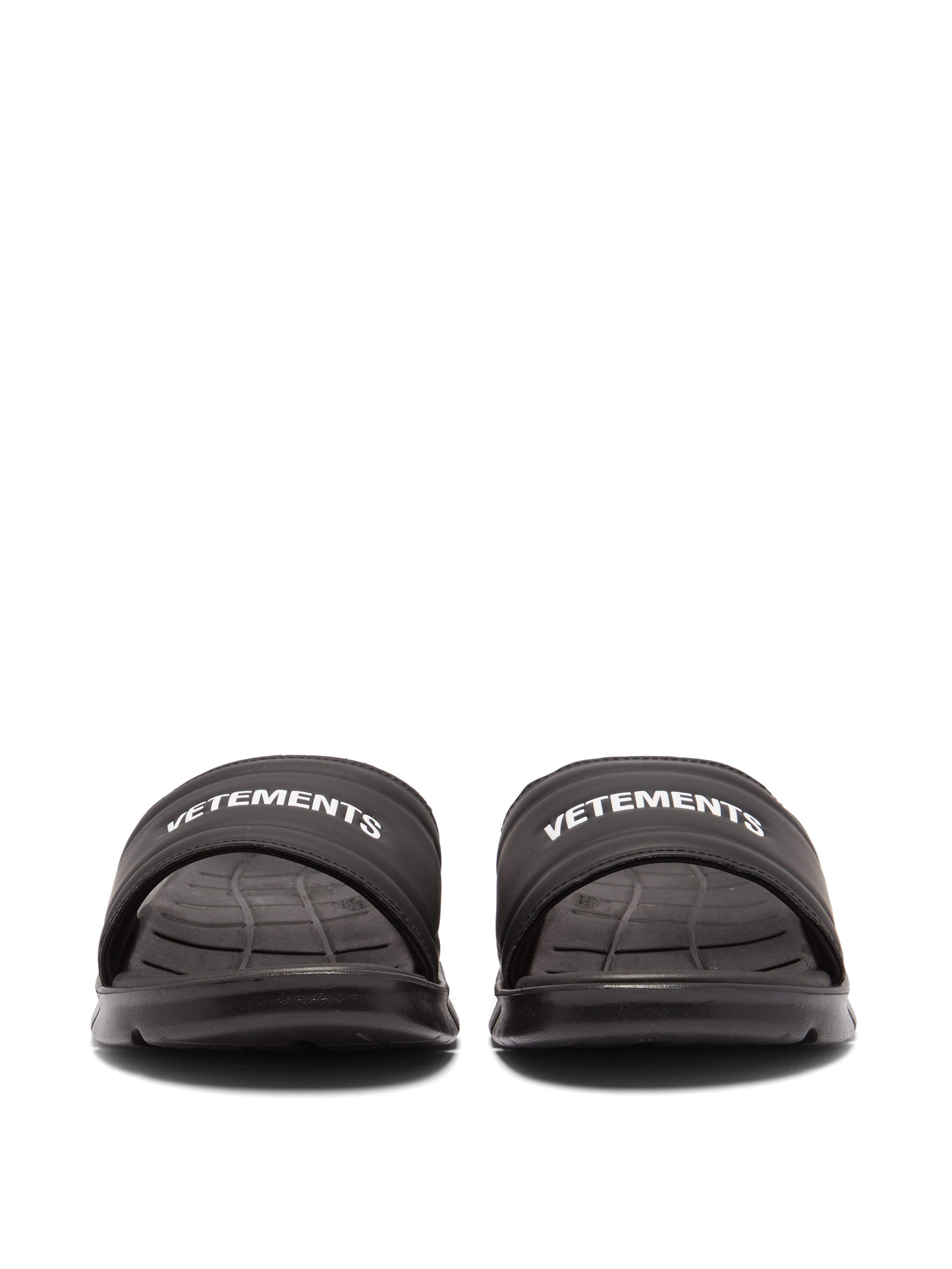 d63cf103a68 Vetements - Black X Reebok Logo Slides - Lyst. View fullscreen