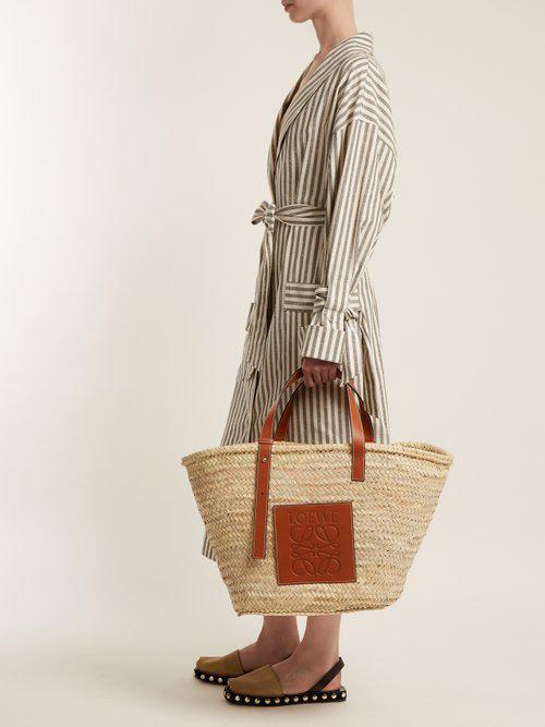 2c4f09e159a Loewe Leather-trimmed Large Raffia Basket Bag in Brown - Lyst