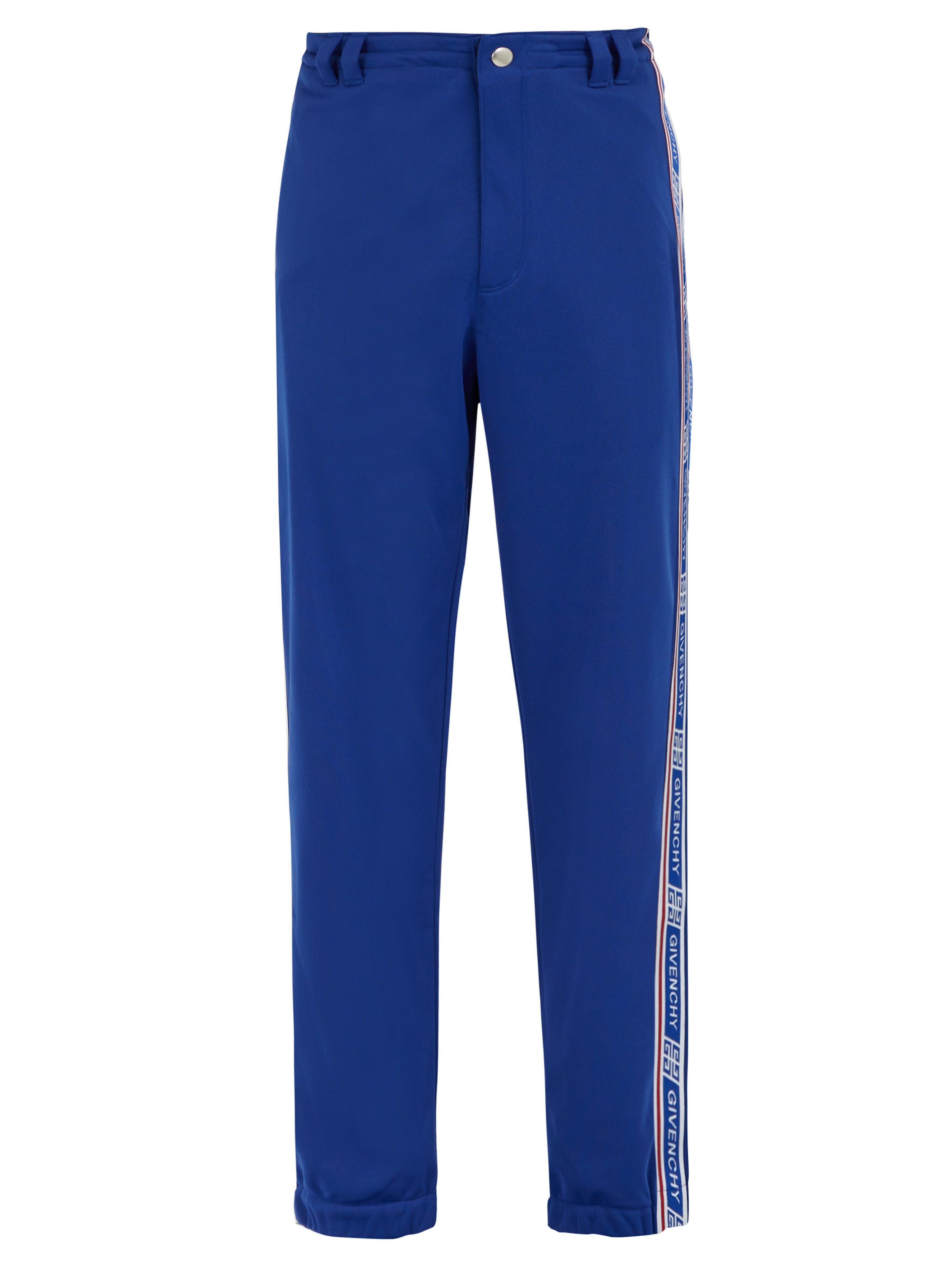 6a049ac297d Givenchy - Blue Pantalon de jogging à bandes latérales logo for Men - Lyst.  Afficher en plein écran