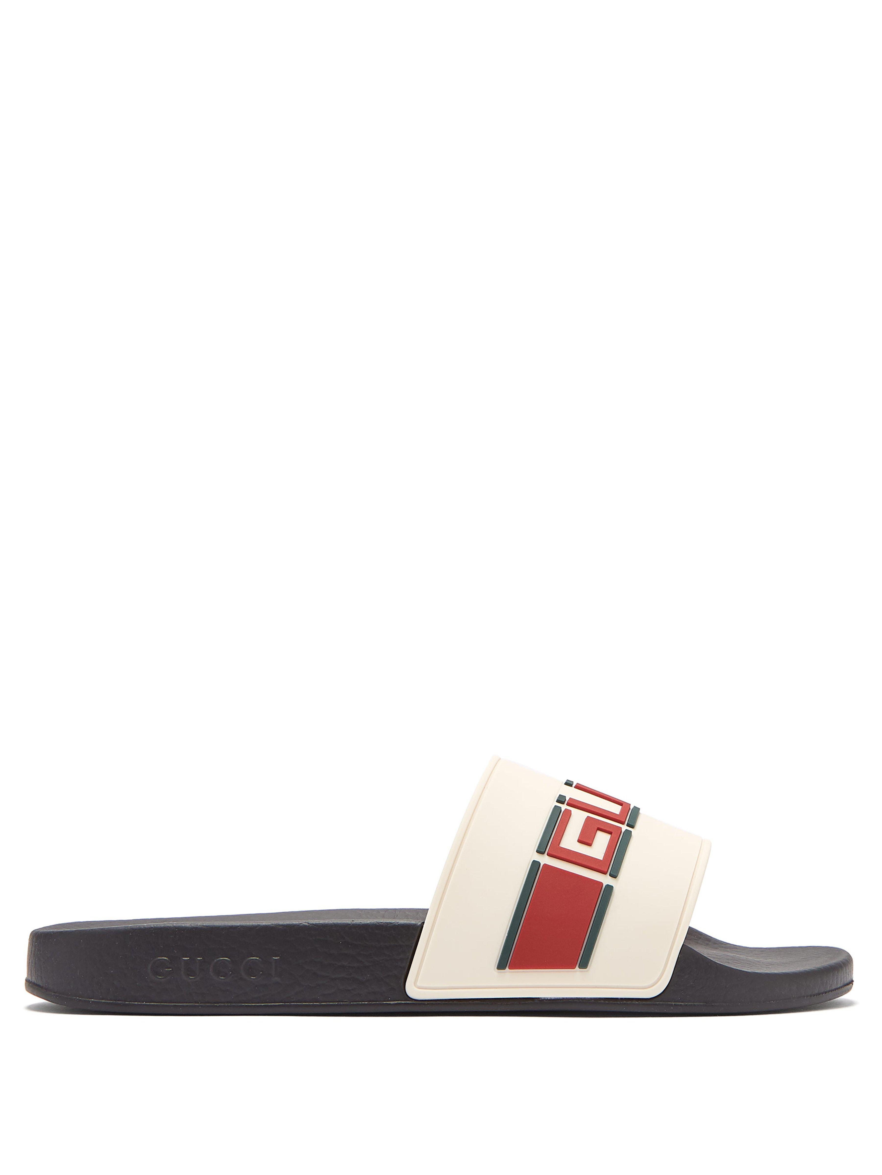 ac4beb0b39d02d Gucci - Multicolor Logo Embossed Rubber Slides for Men - Lyst. View  fullscreen