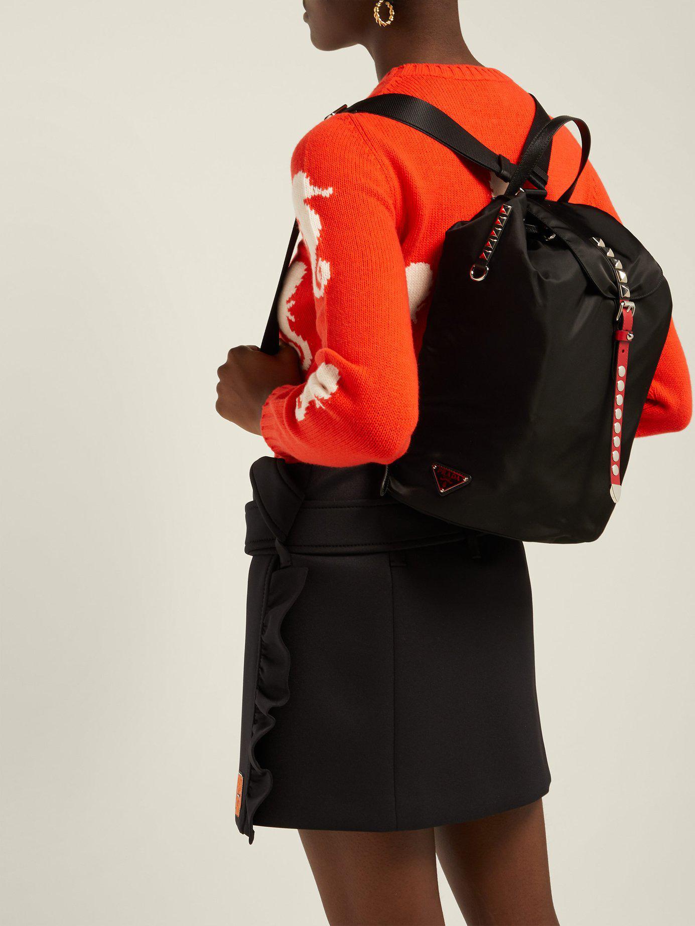 febb46c85ff7 Lyst - Prada New Vela Studded Nylon Backpack in Black