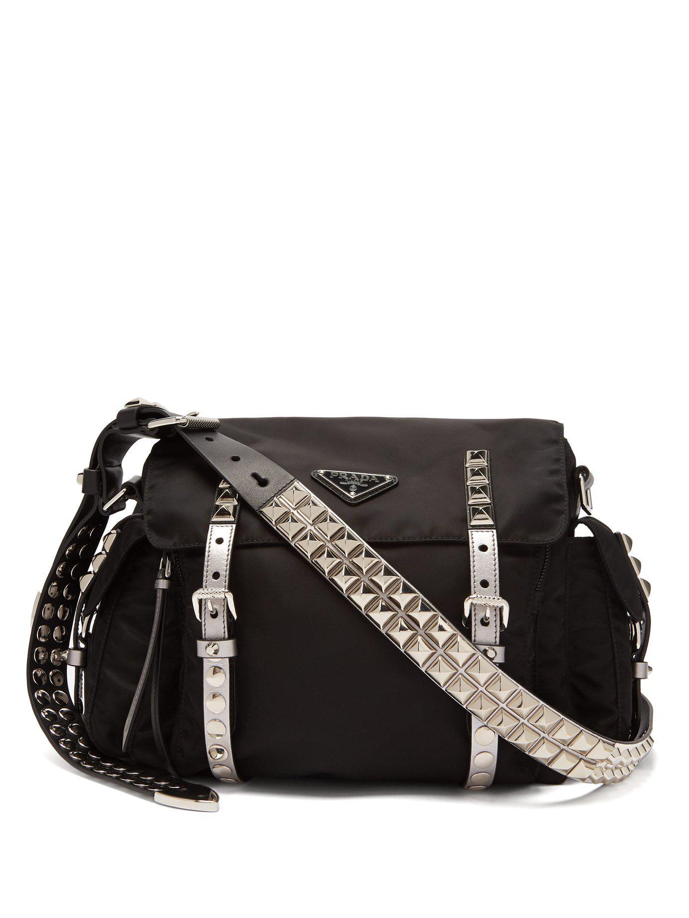 8835ed490062 Prada New Vela Leather Trimmed Cross Body Bag in Black - Lyst
