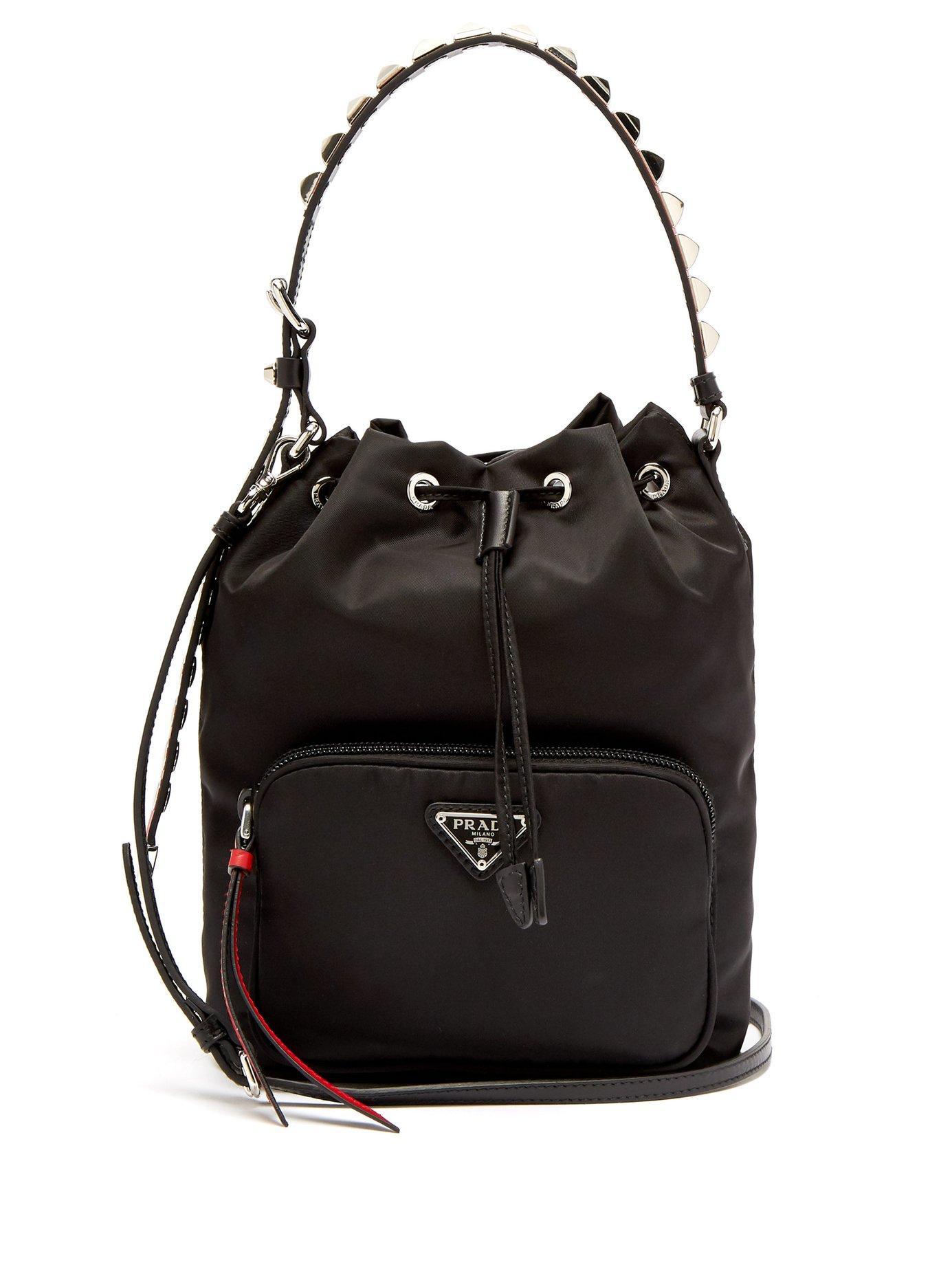 7e0664e74ed8 Prada New Vela Studded Nylon Bucket Bag in Black - Lyst