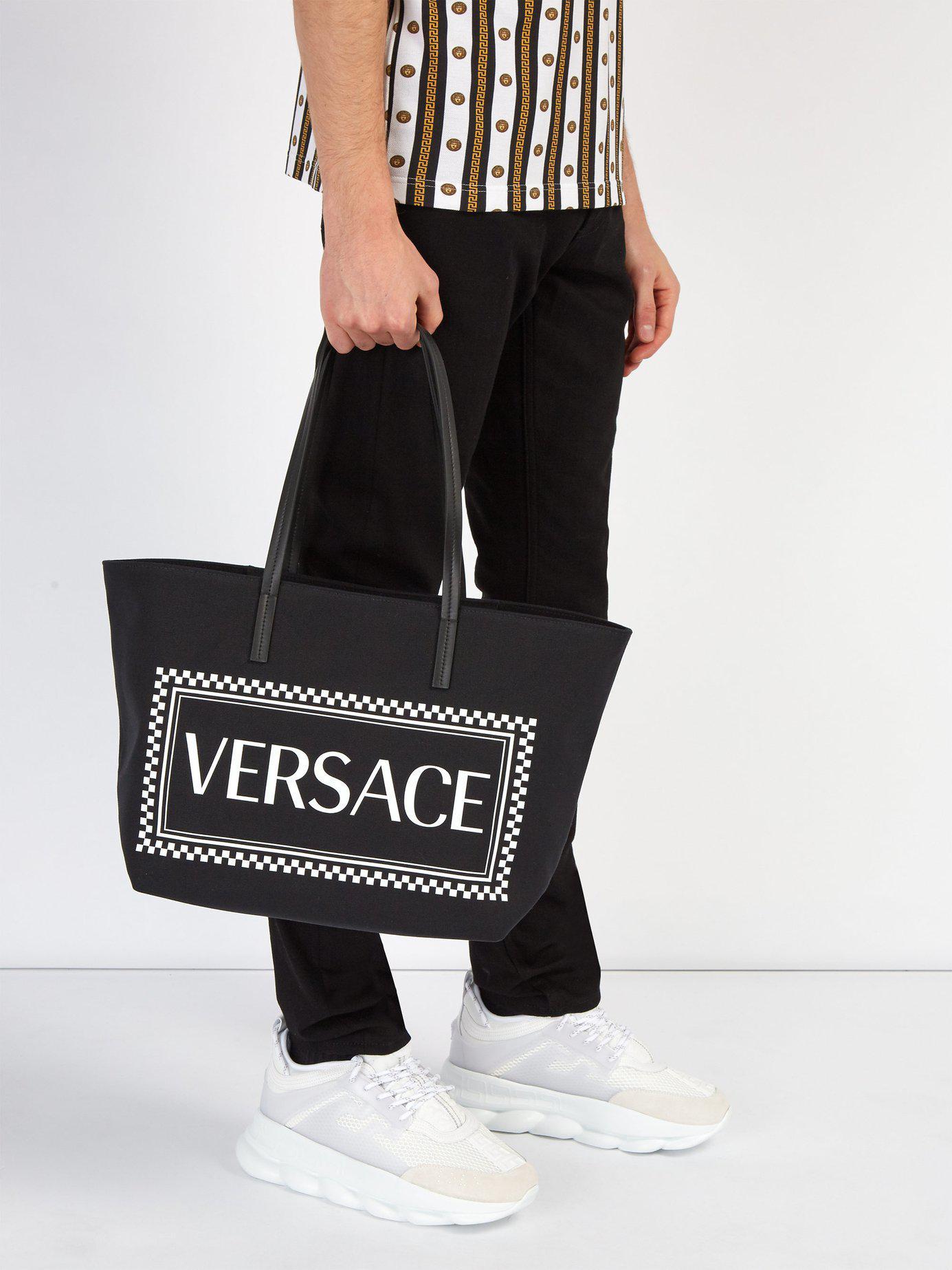 6c0596a0fb23 Versace - Black Logo Print Canvas Tote for Men - Lyst. View fullscreen