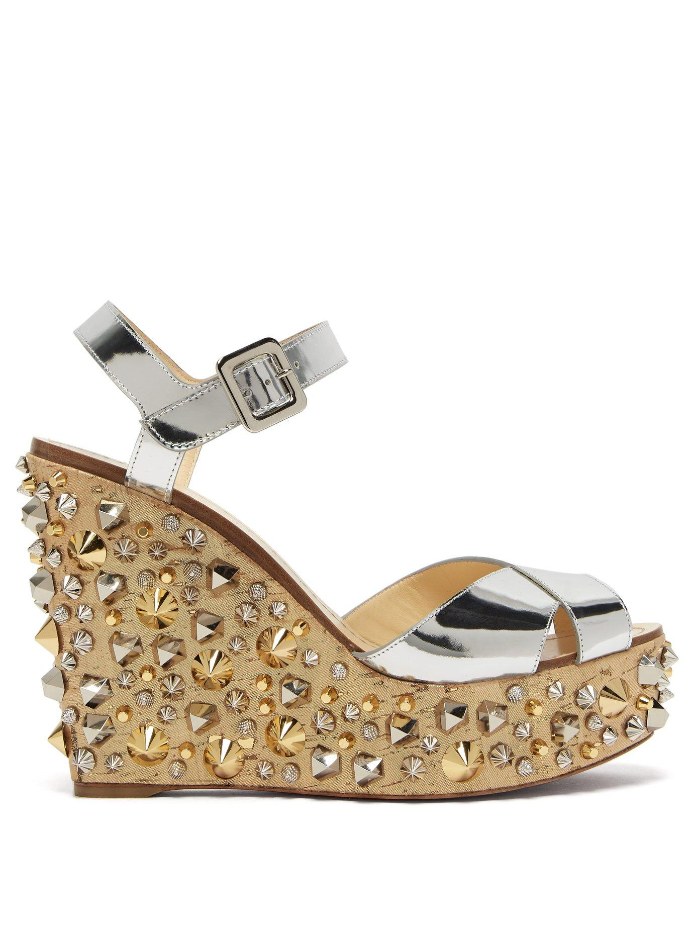 4bb3834200ea Christian Louboutin. Women s Metallic Almericca 120 Cork Lamé Studded Wedge  Sandals