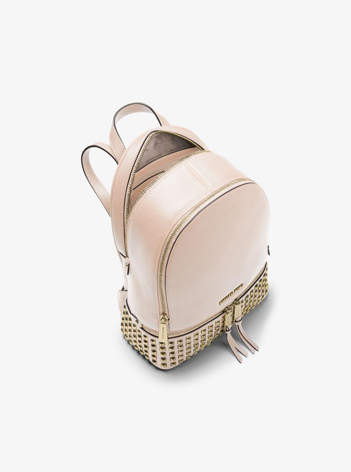 ad1b0d48fc19 ... where to buy michael kors pink rhea medium studded leather backpack  lyst. view fullscreen 19395