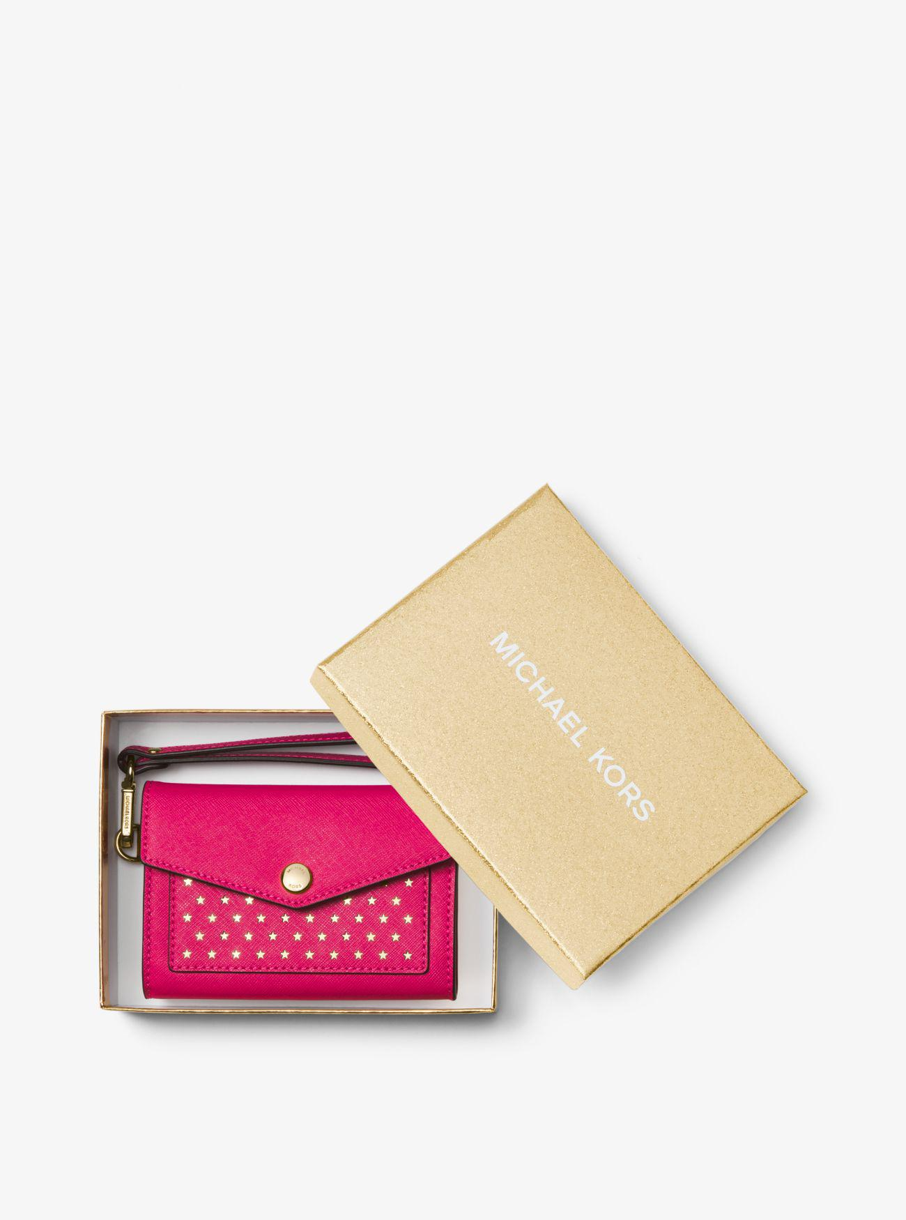 8891553a7bc1 Lyst - Michael Kors Perforated Saffiano Leather Wristlet in Pink