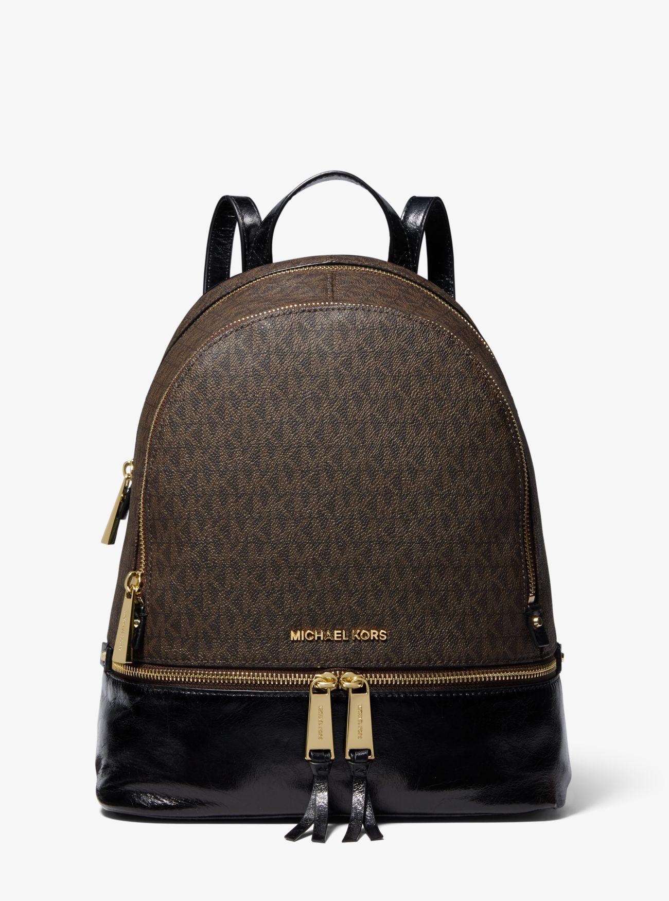 168b473e4ecd MICHAEL Michael Kors. Women s Brown Rhea Medium Logo And Leather Backpack