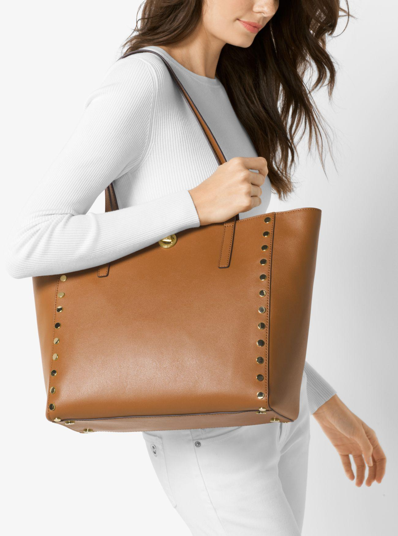 09257285ac19b Lyst - Michael Kors Rivington Large Studded Leather Tote in Brown