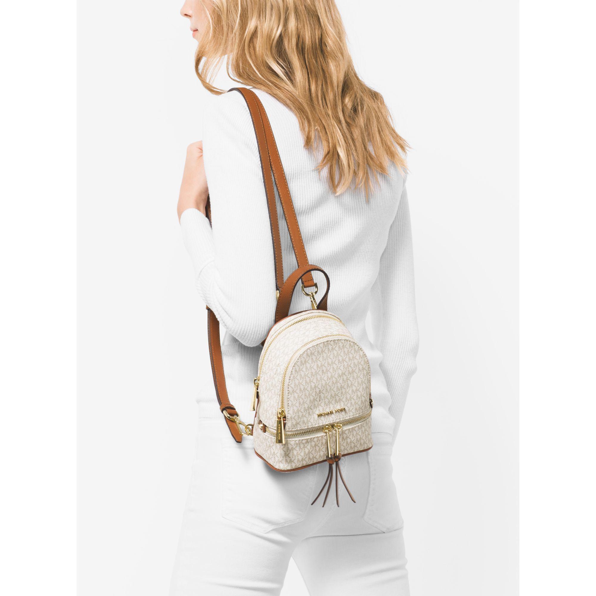 e408f801ba0e Michael Kors Rhea Extra-small Logo Backpack in Natural - Lyst