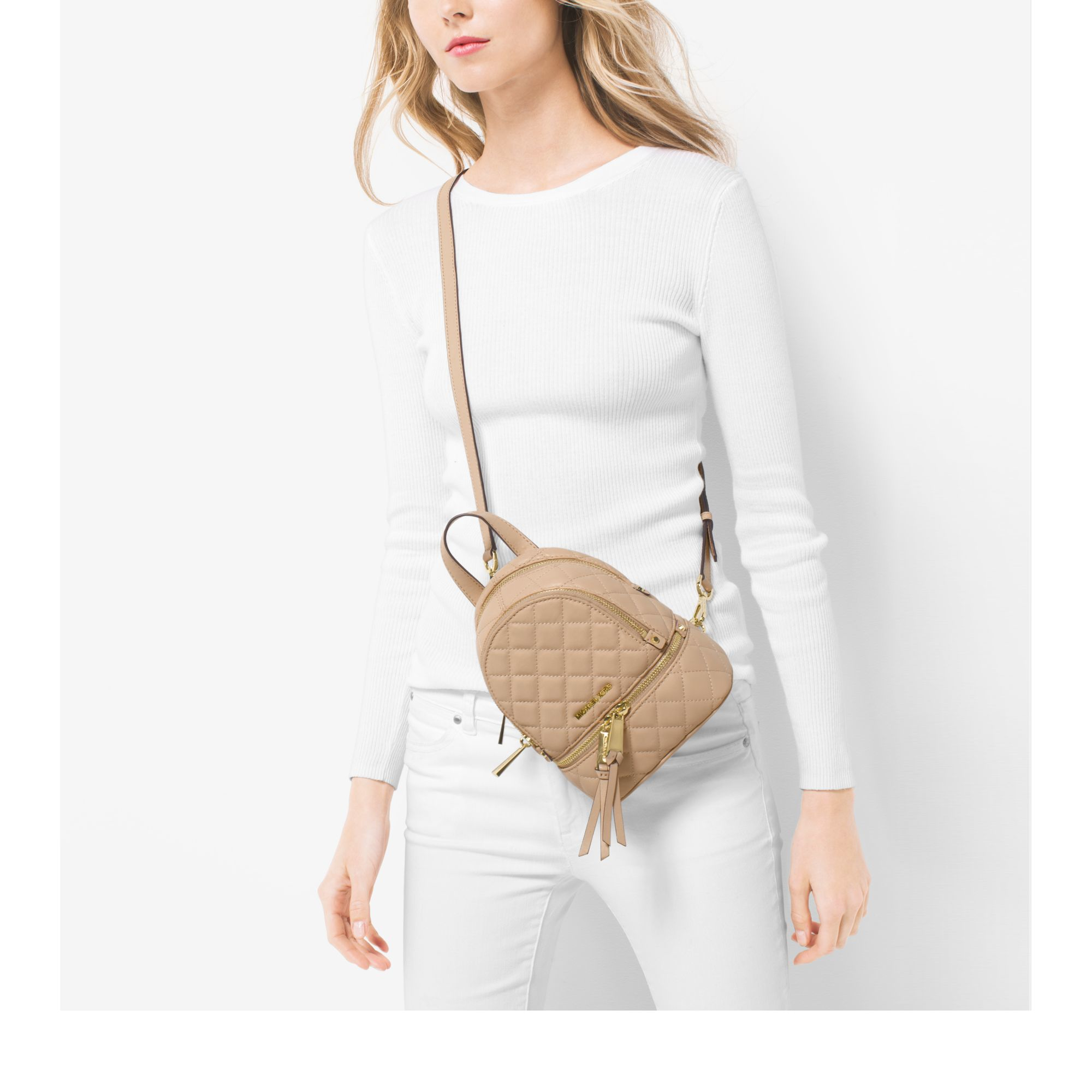 219a5385d380 Lyst - Michael Kors Rhea Extra-small Quilted-leather Backpack in Natural