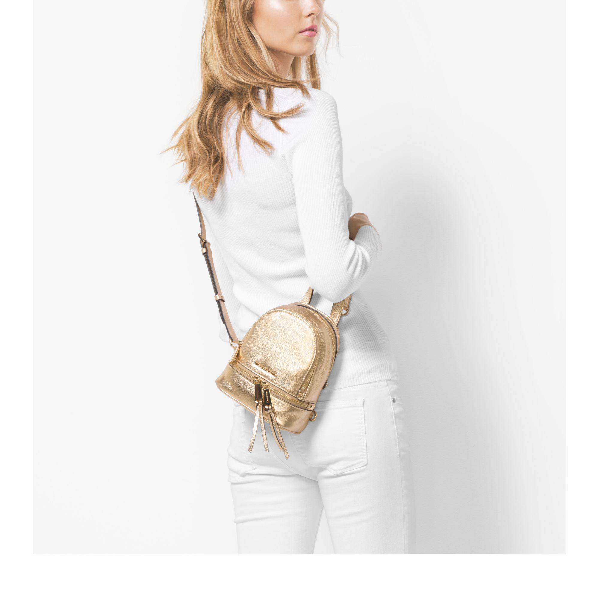 dd4c16e97058 ... promo code for michael kors rhea extra small metallic leather backpack  in metallic lyst 9ea90 4615b