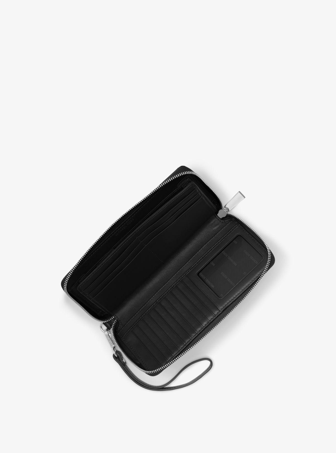 3c1e4f8b34dc MICHAEL Michael Kors - Black Quilted-leather Continental Wristlet - Lyst.  View fullscreen