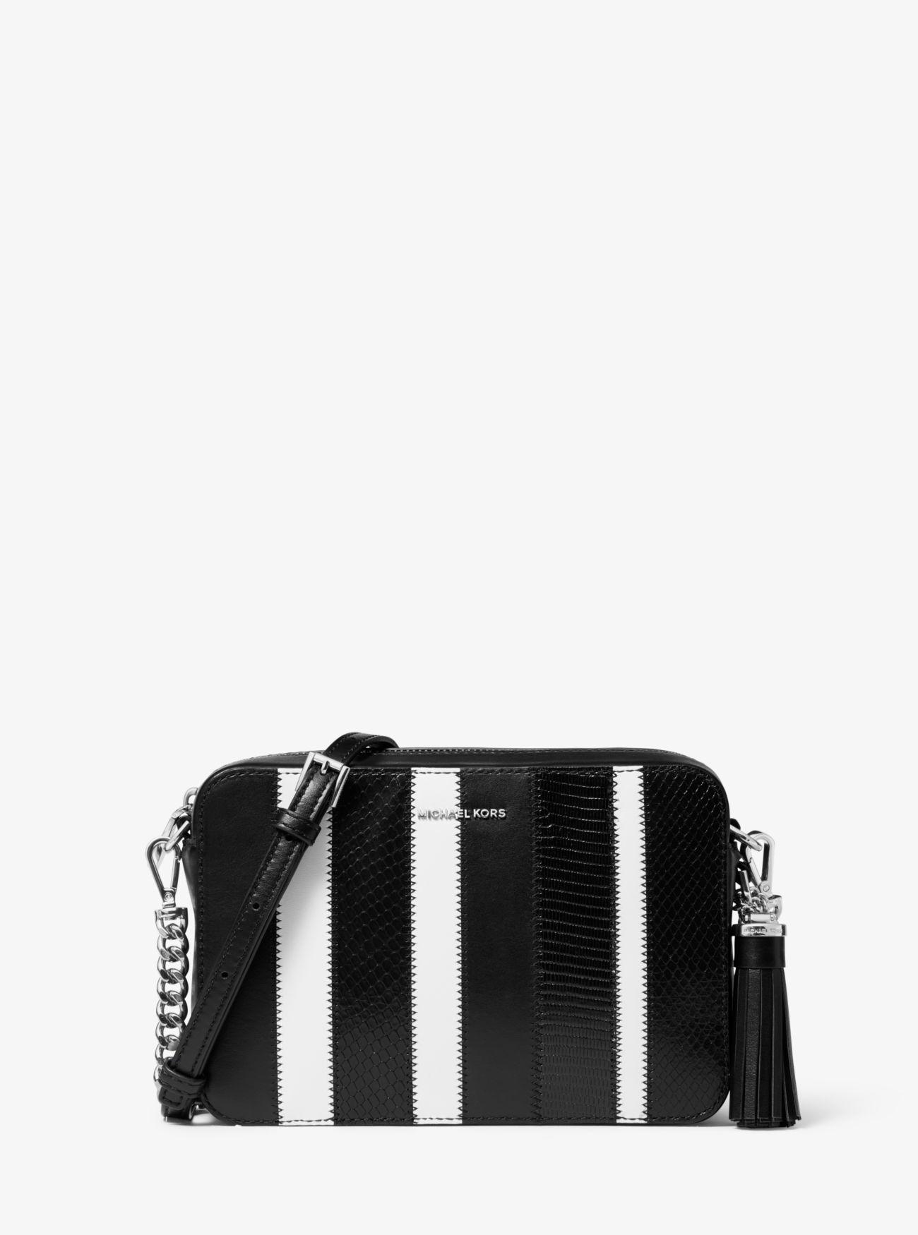 8b5006db26f2 MICHAEL Michael Kors. Women's Black Ginny Medium Striped Leather Crossbody  Bag