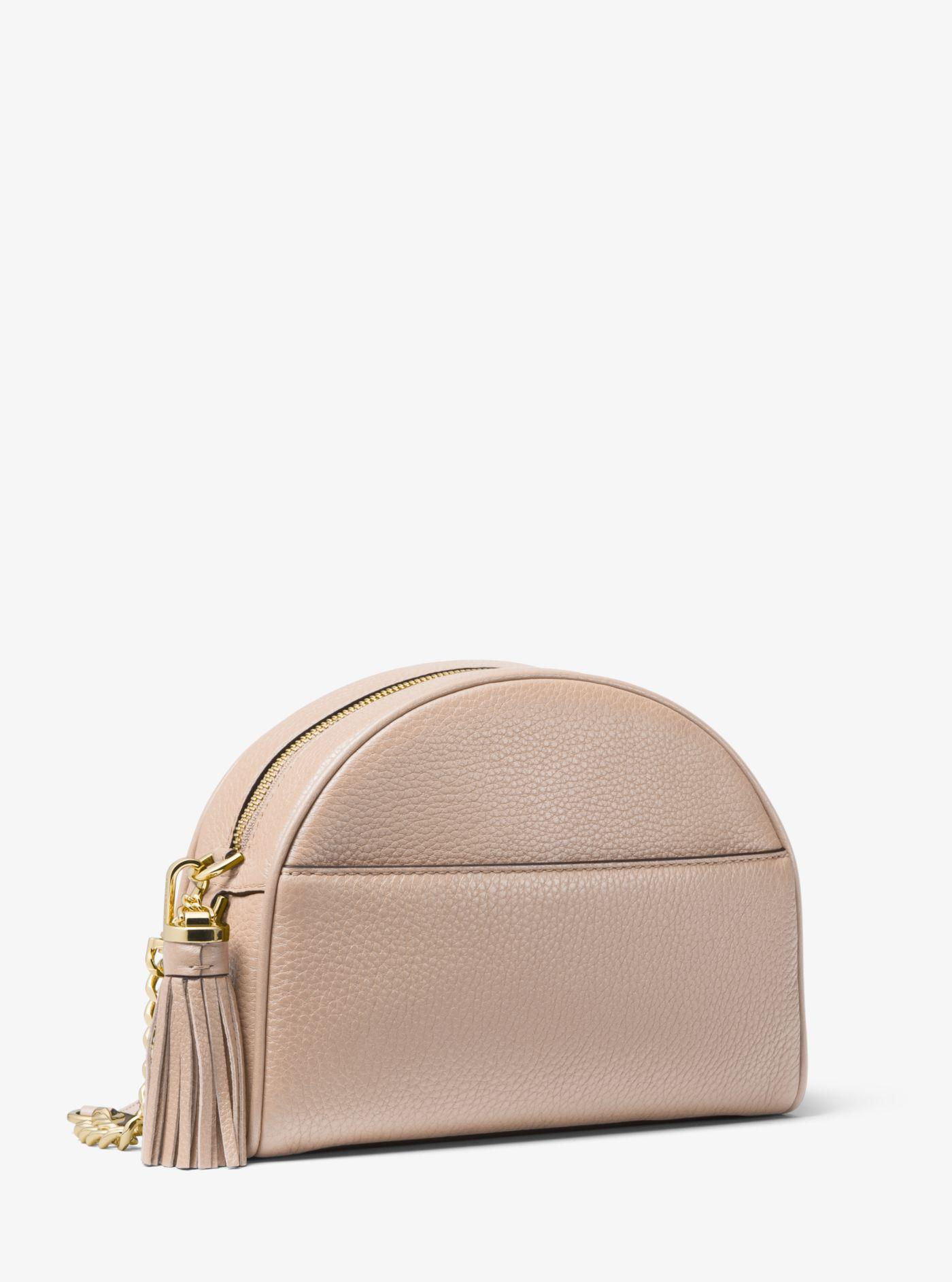 736f9a60100e Michael Kors Ginny Pebbled Leather Half-moon Crossbody in Pink - Lyst