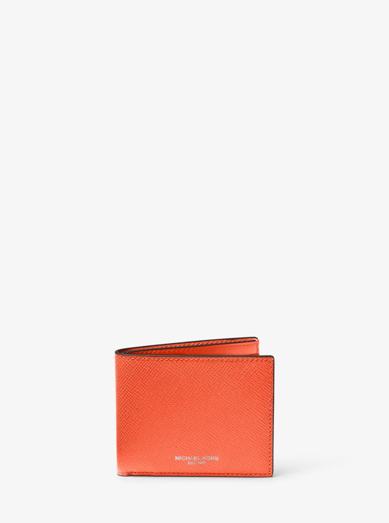 7287880797a9 Lyst - Michael Kors Harrison Leather Slim Billfold Wallet in Orange ...
