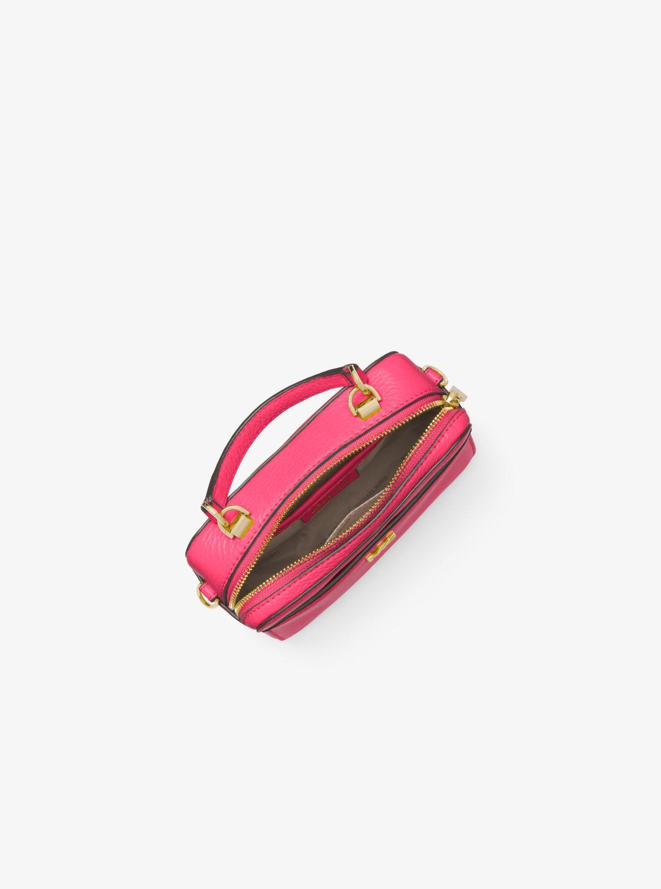 44706e02a192 Michael Kors Pink Mott Mini Pebbled Leather Crossbody