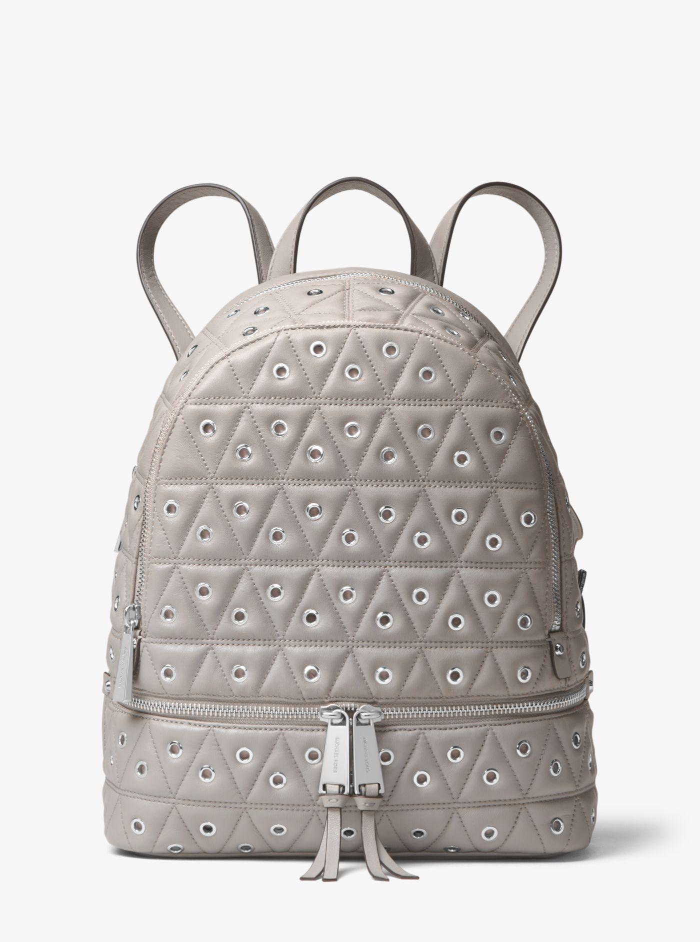 a846e33b0dc10 Lyst - Michael Kors Rhea Medium Grommeted Leather Backpack in Gray