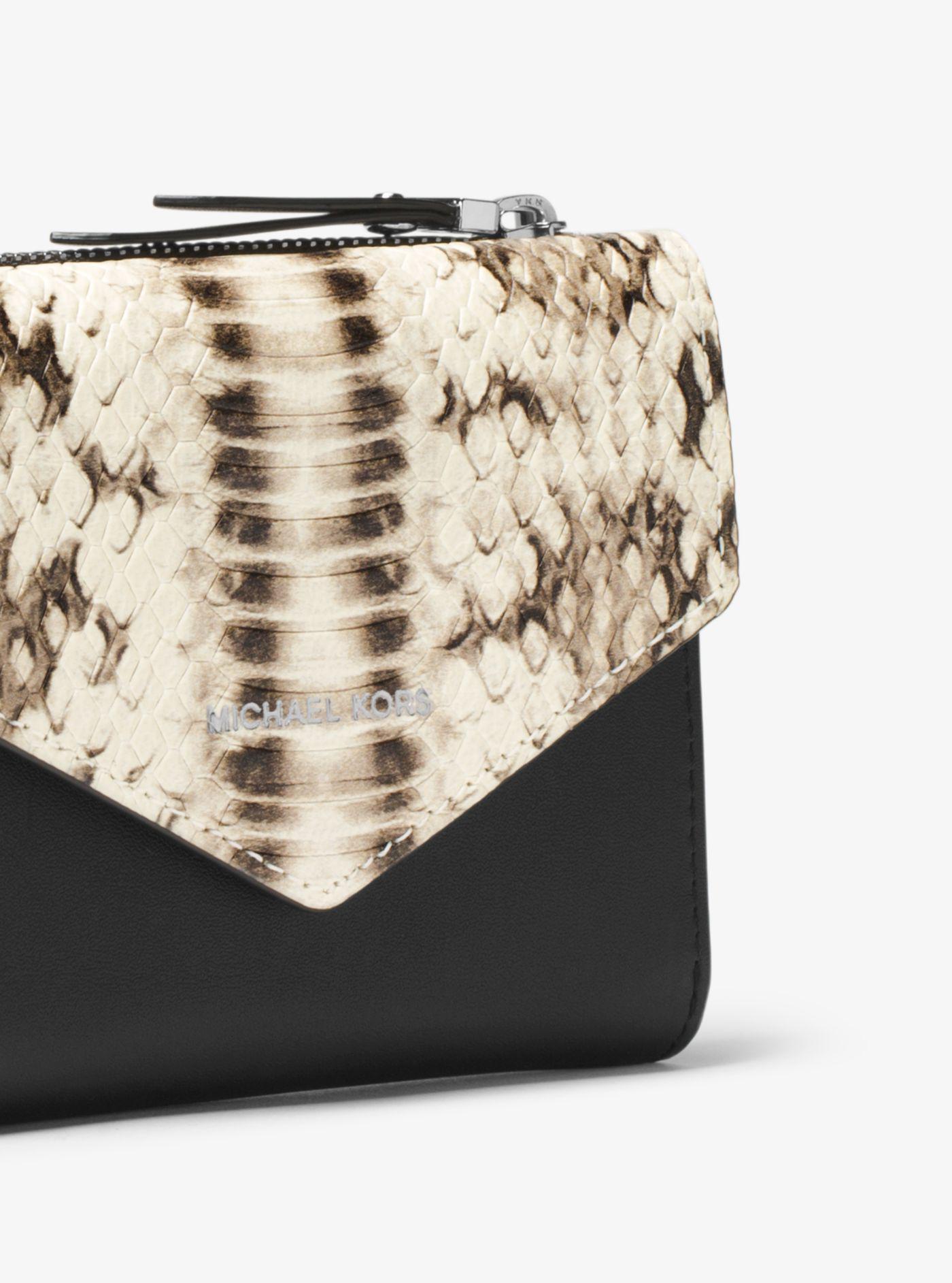 5b0f579e58781e Michael Kors Jet Set Small Embossed Leather Envelope Wallet in Black ...