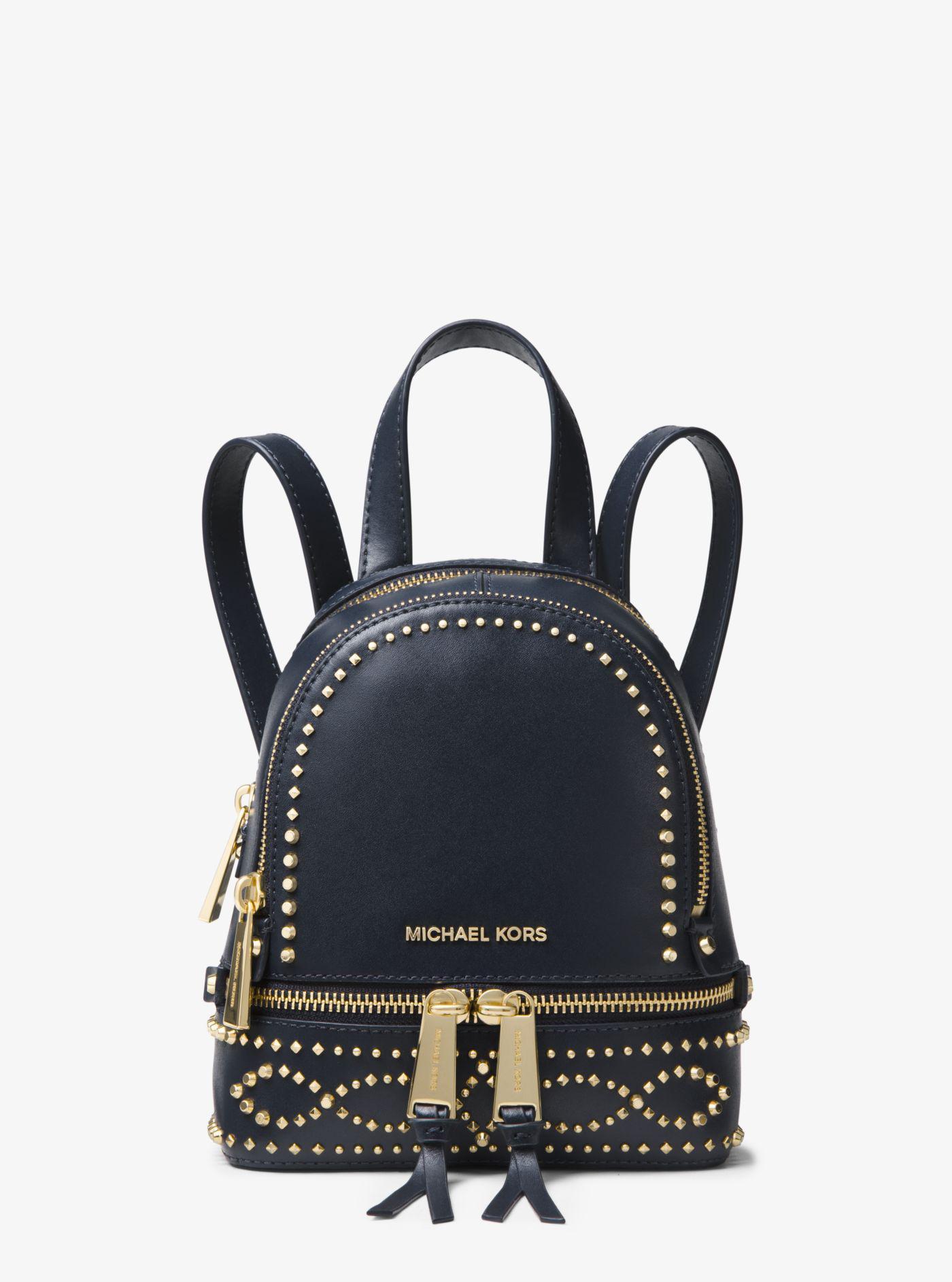 69438fb37a1 Lyst - Michael Kors Rhea Mini Studded Leather Backpack