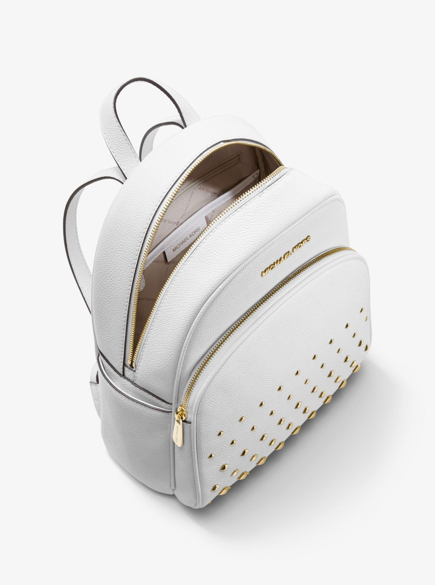 20e0d4d0f0ff9a Michael Kors Abbey Medium Studded Pebbled Leather Backpack in White ...