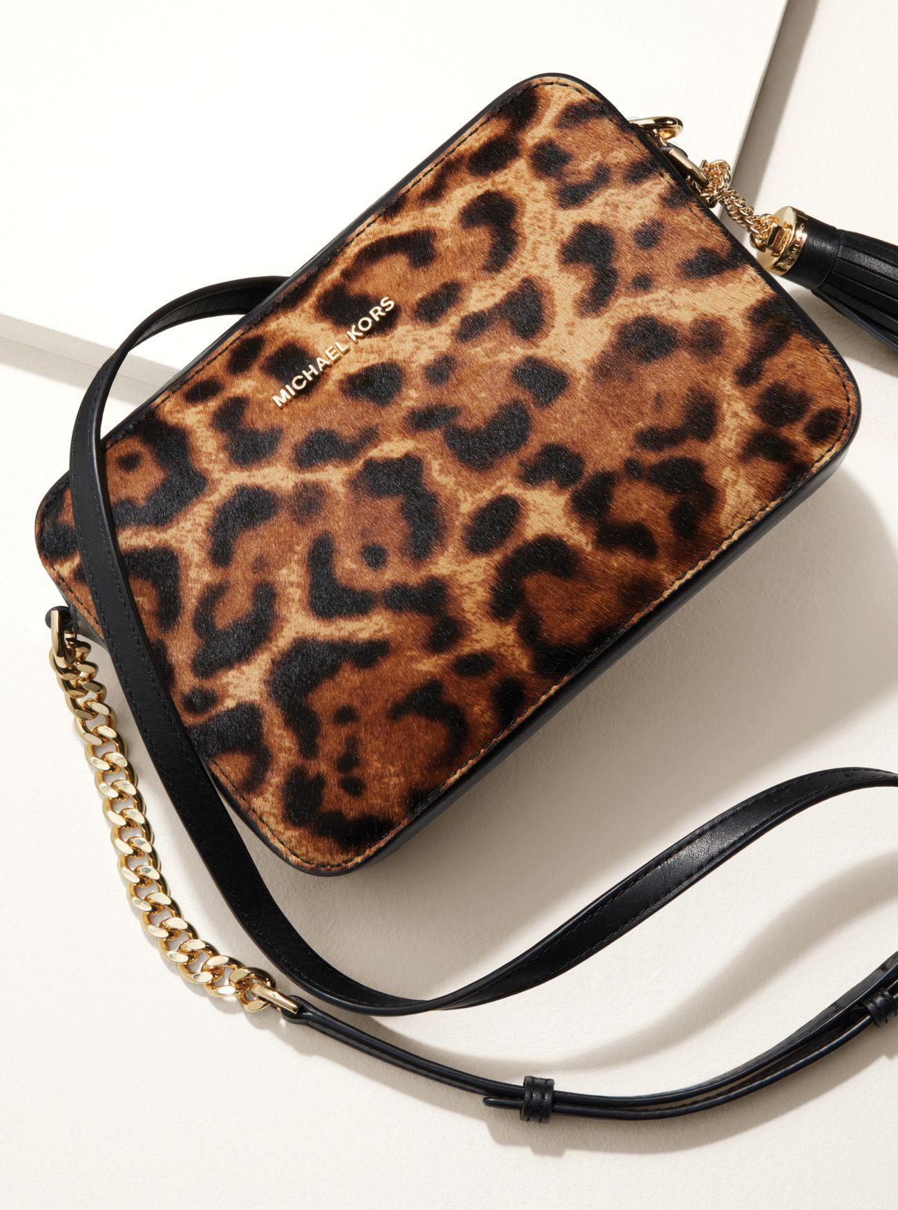 a307d650be0d ... Lyst - Michael Kors Ginny Medium Leopard Calf Hair Crossbody ...