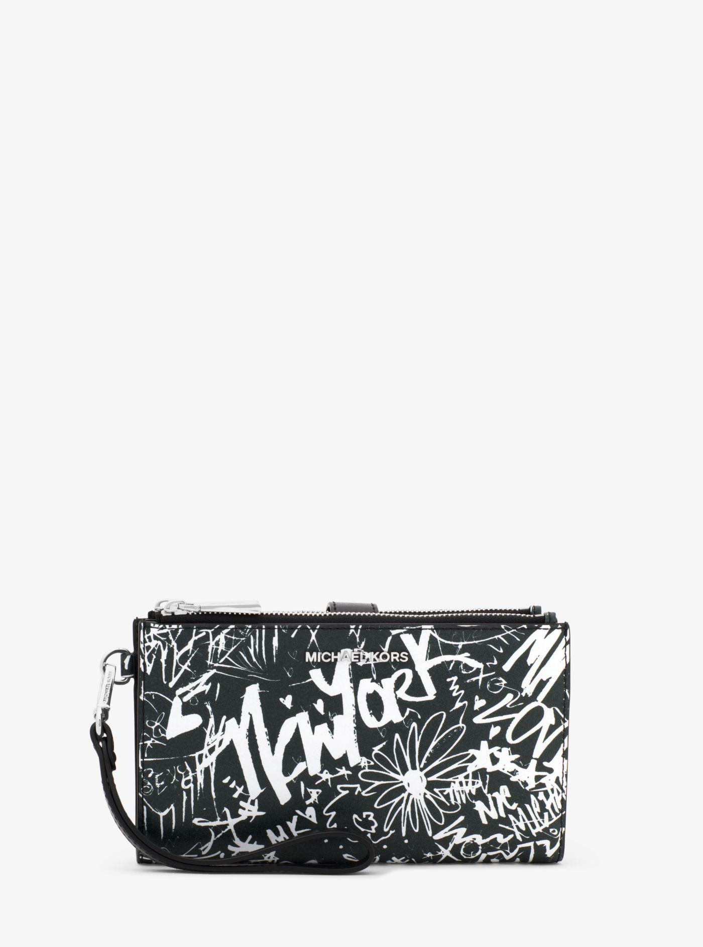 260018bf5843 discount code for michael kors black adele graffiti leather smartphone  wallet lyst. view fullscreen 748b2