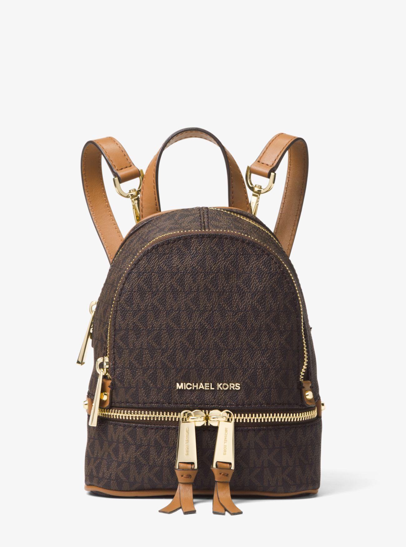 c0eec021920c Michael Kors - Brown Rhea Mini Logo Backpack - Lyst. View fullscreen