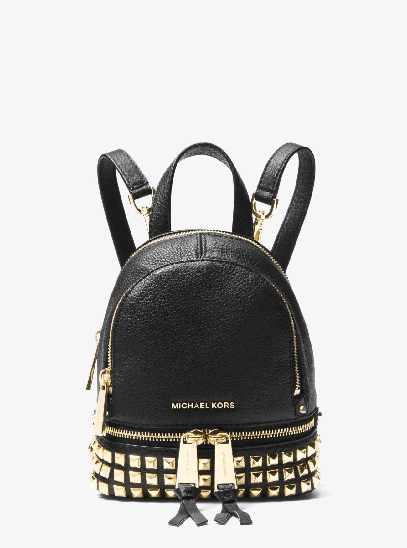 70522689788b Lyst - MICHAEL Michael Kors Rhea Mini Studded Leather Backpack in Black