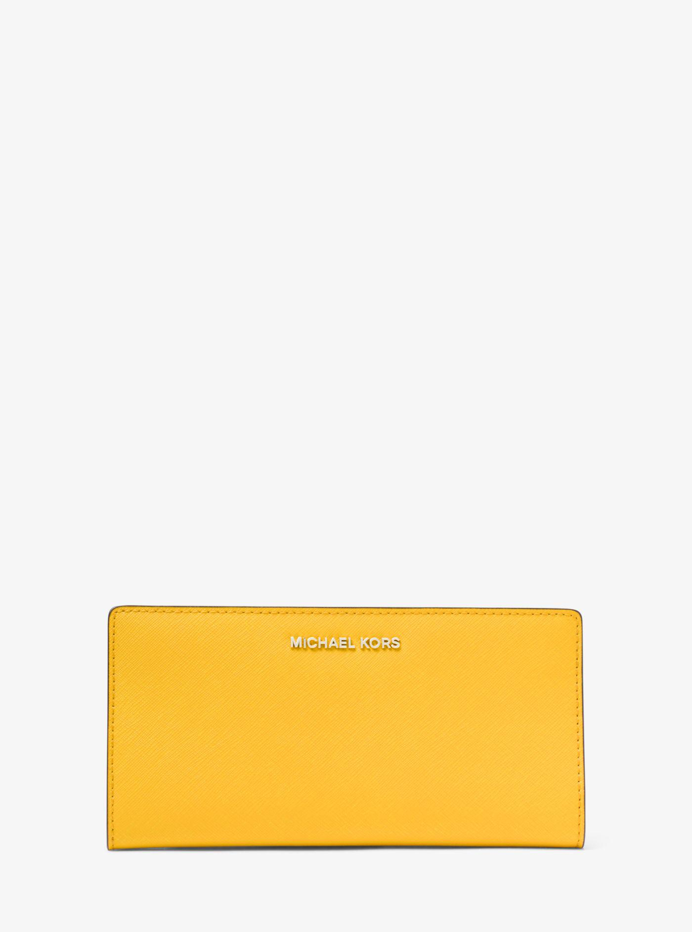 4e81ad0d6cc8 ... discount lyst michael kors large saffiano leather slim wallet in yellow  41c21 a0cdf