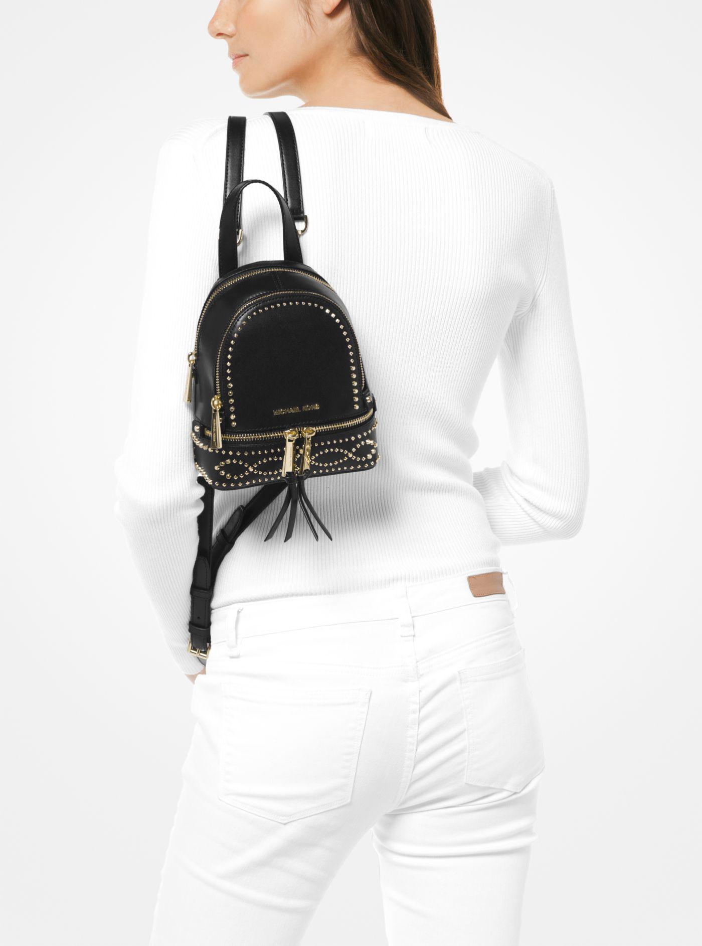 95478e8fb3ca Michael Kors Rhea Mini Studded Leather Backpack in Black - Lyst