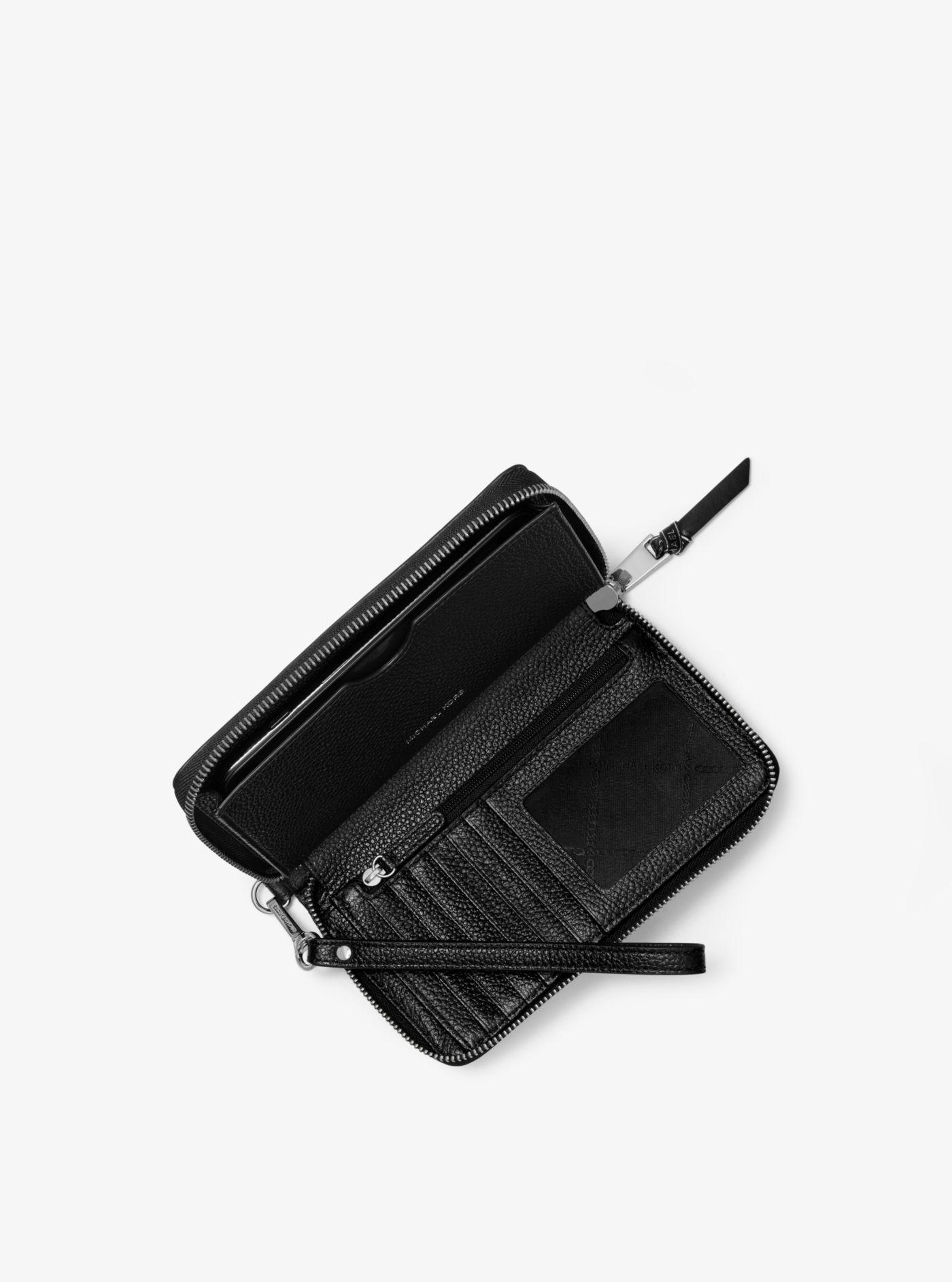 350e2f8c64c3 Michael Kors - Black Large Striped Pebbled Leather Smartphone Wristlet -  Lyst. View fullscreen
