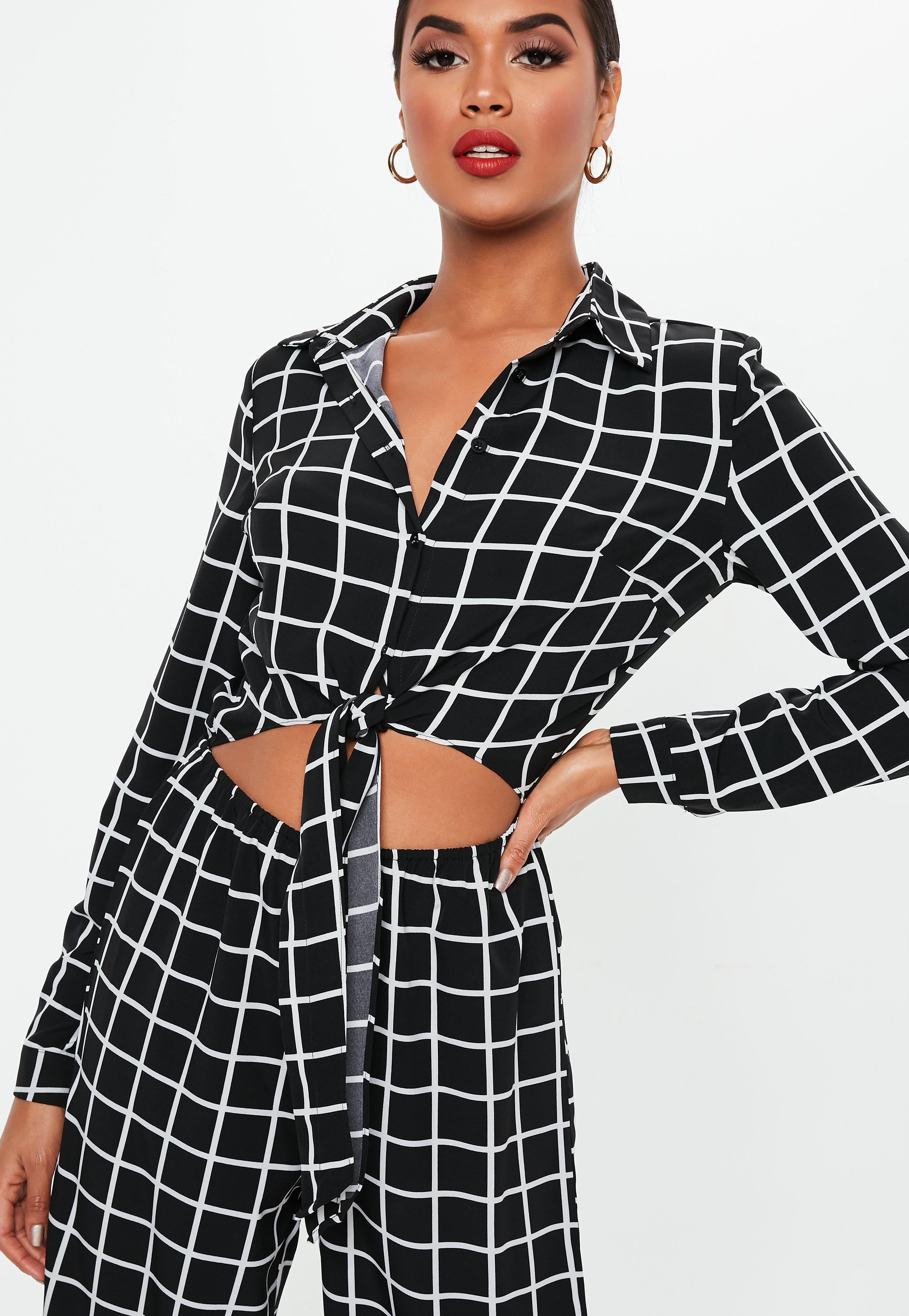 e56c0cdebc2 Lyst - Missguided Black Grid Print Long Sleeve Tie Front Jumpsuit in ...