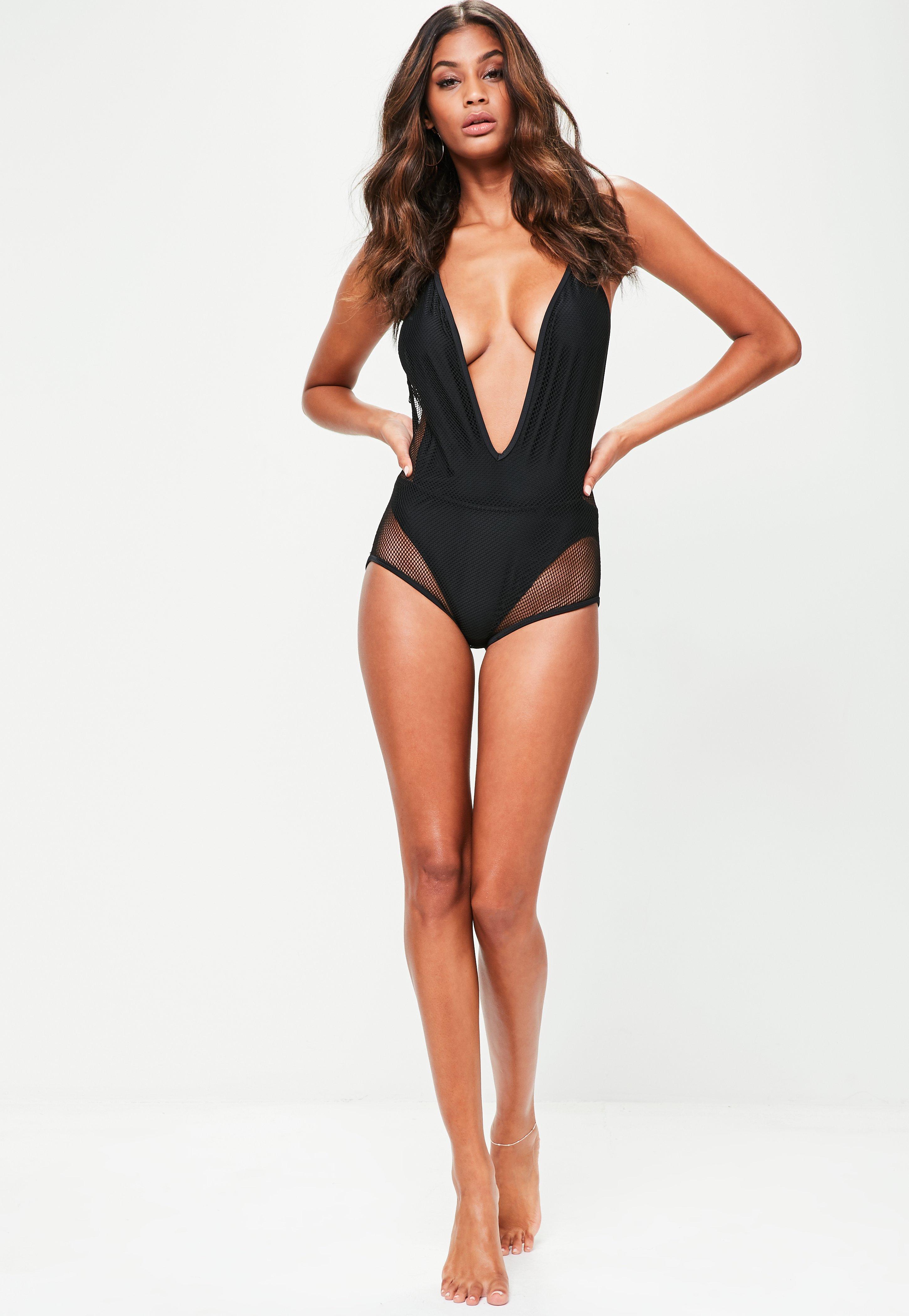 4763b97e52378 Lyst - Missguided Black Fishnet Plunge Swimsuit in Black