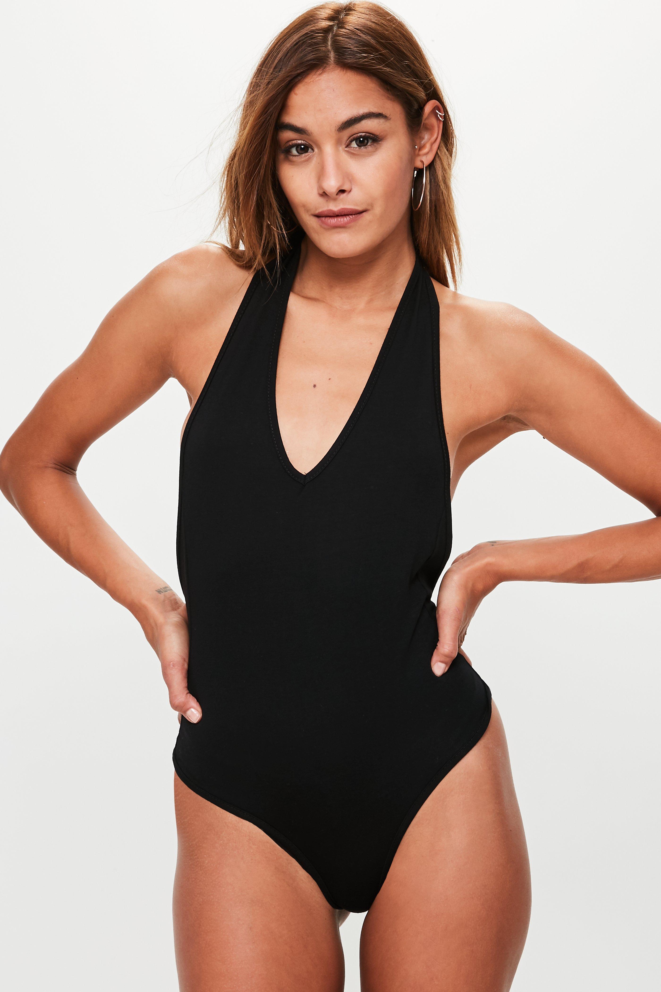 c7060d46135cc Lyst - Missguided Black Deep Plunge Halter Bodysuit in Black - Save 65%