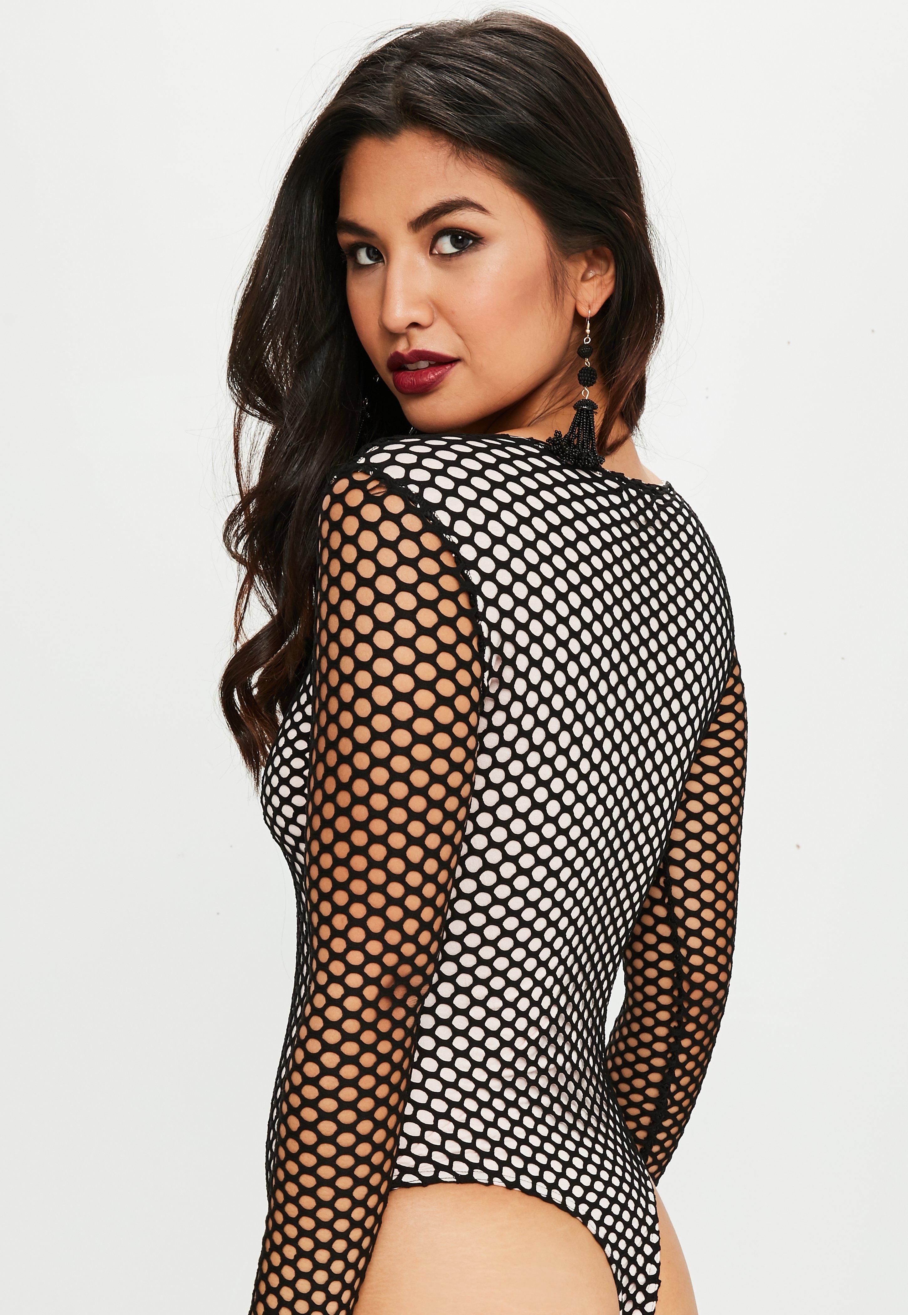 8d6e53fe96ed Lyst - Missguided Black Fishnet Long Sleeve Bodysuit in Black
