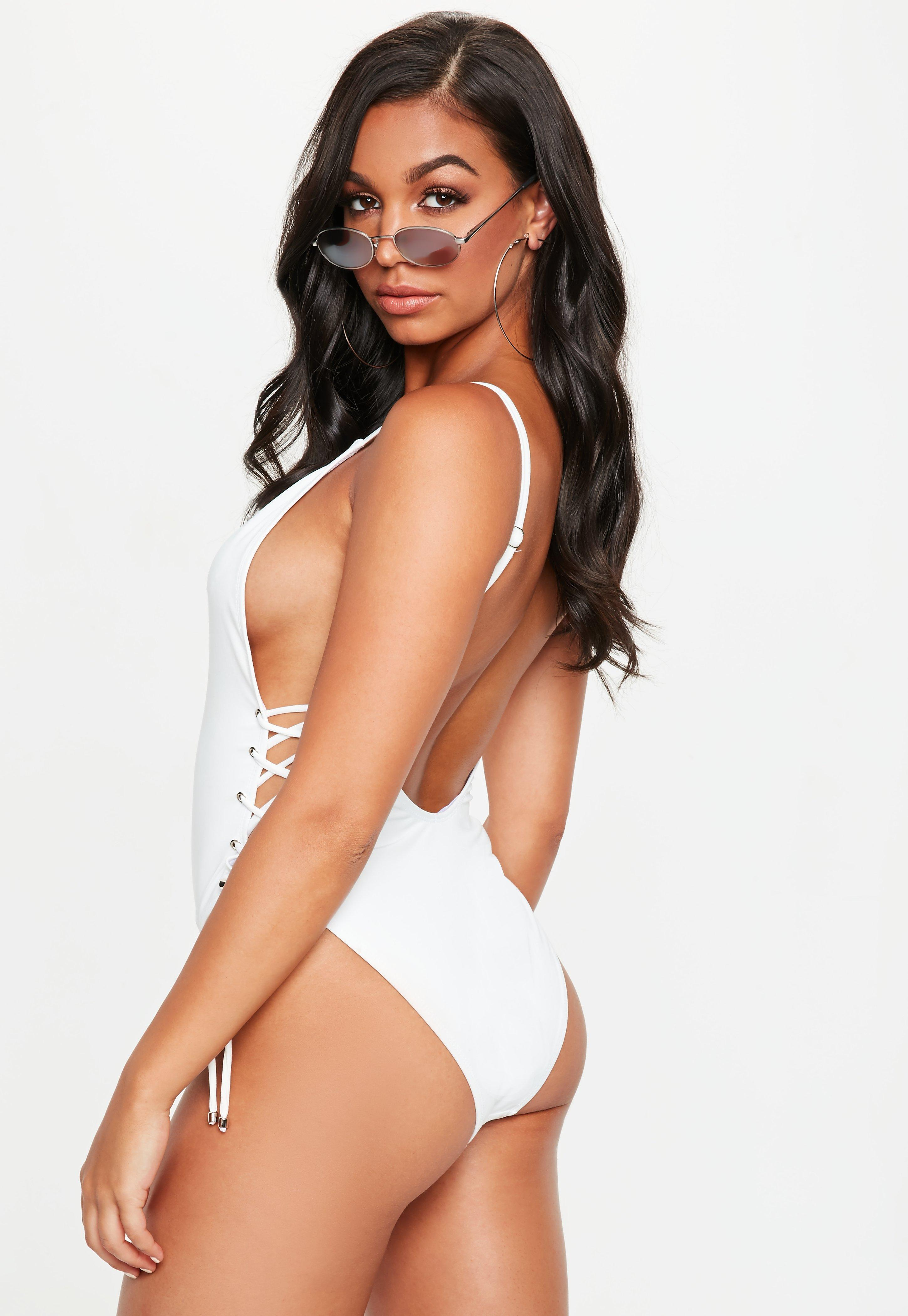 da7a913dcd573 Missguided - White Low Back Lace Up Side Swimsuit - Lyst. View fullscreen