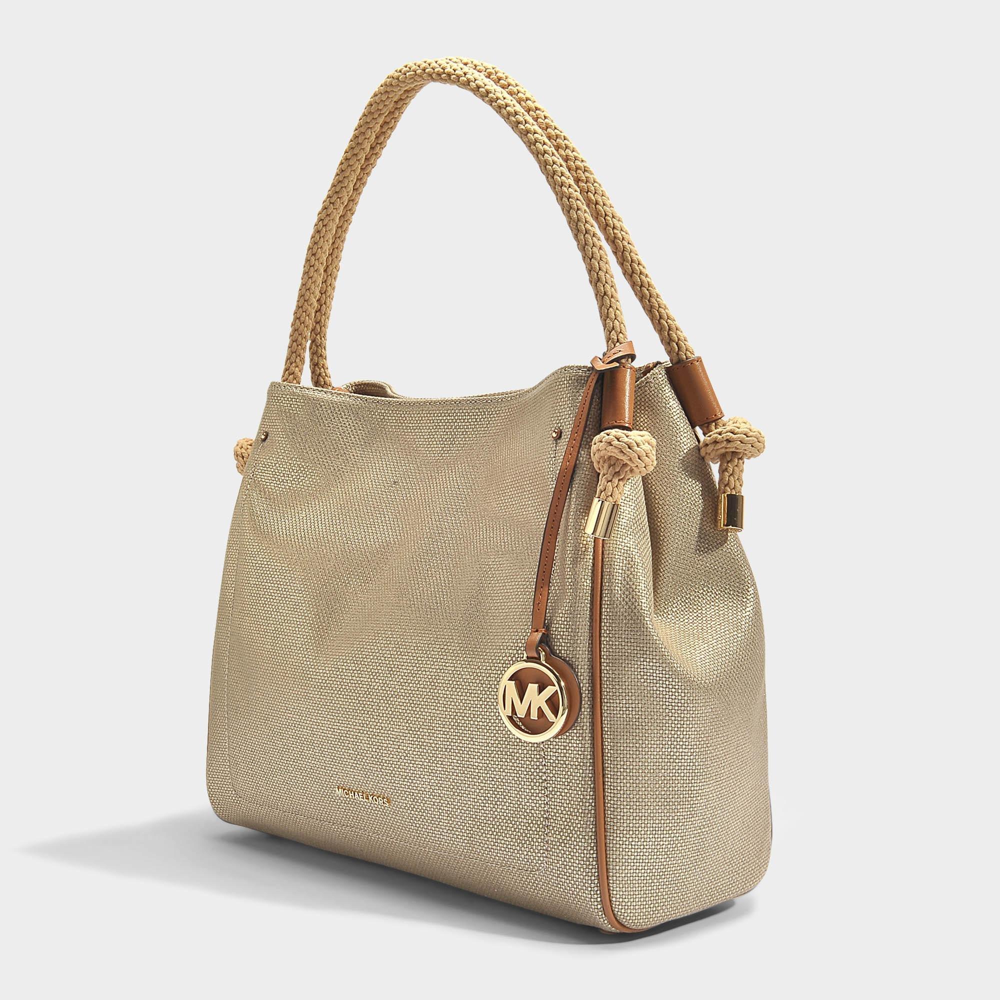 9f547ba57aab MICHAEL Michael Kors Isla Large Grab Bag In Pale Gold Metallic ...