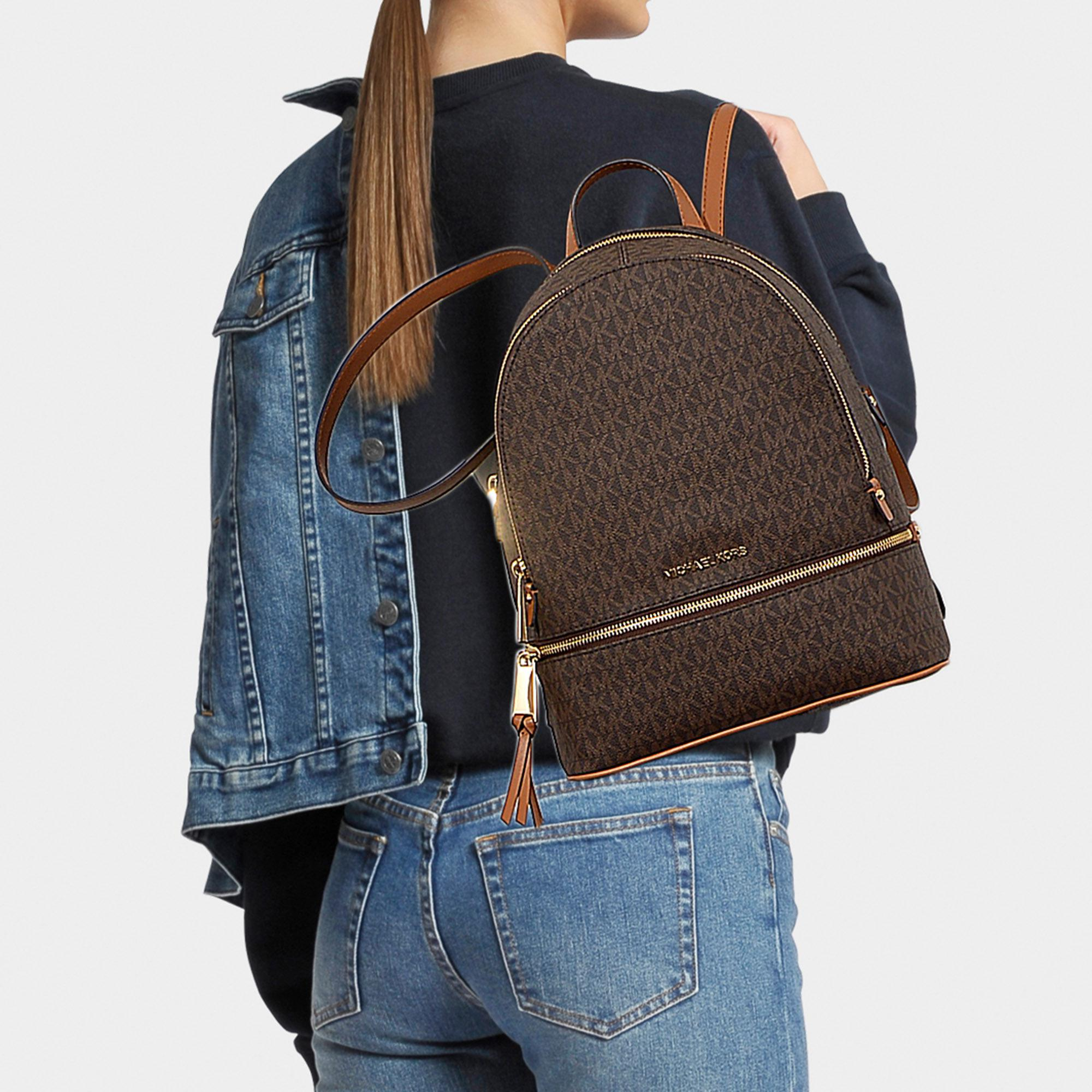 73899d91e5 ... spain michael michael kors rhea zip medium backpack in brown canvas  lyst. view fullscreen 1d71f