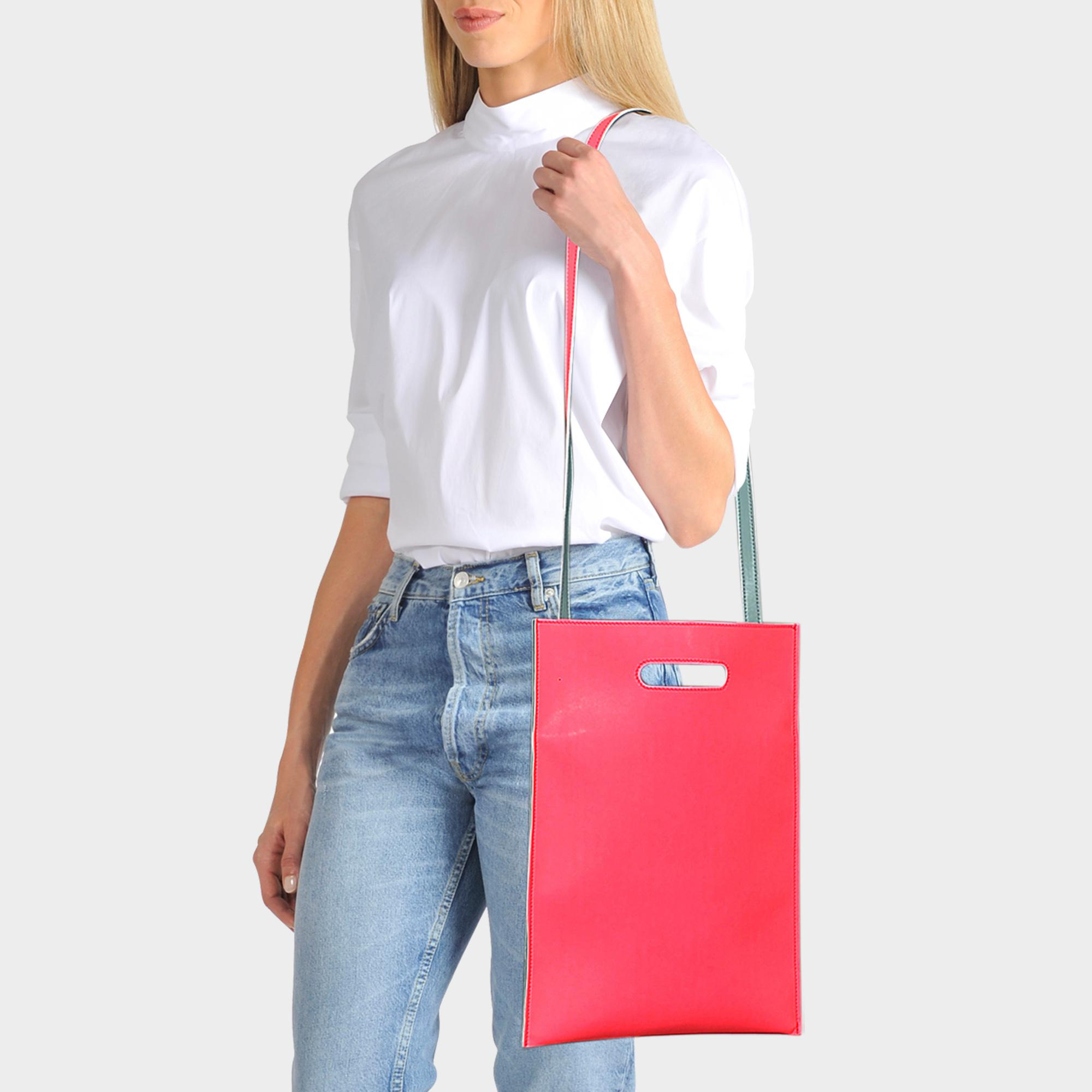 6463a91357a8 mm6-by-maison-martin-margiela--Hand-Carry-Plastic -Bag-In-Neon-Pink-Synthetic-Leather.jpeg