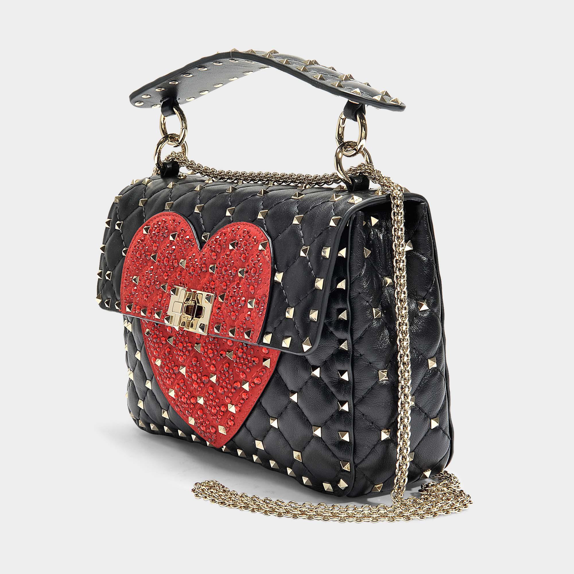 d78135a6885 Lyst - Sac à main rockstud spike it heart medium en cuir de veau ...