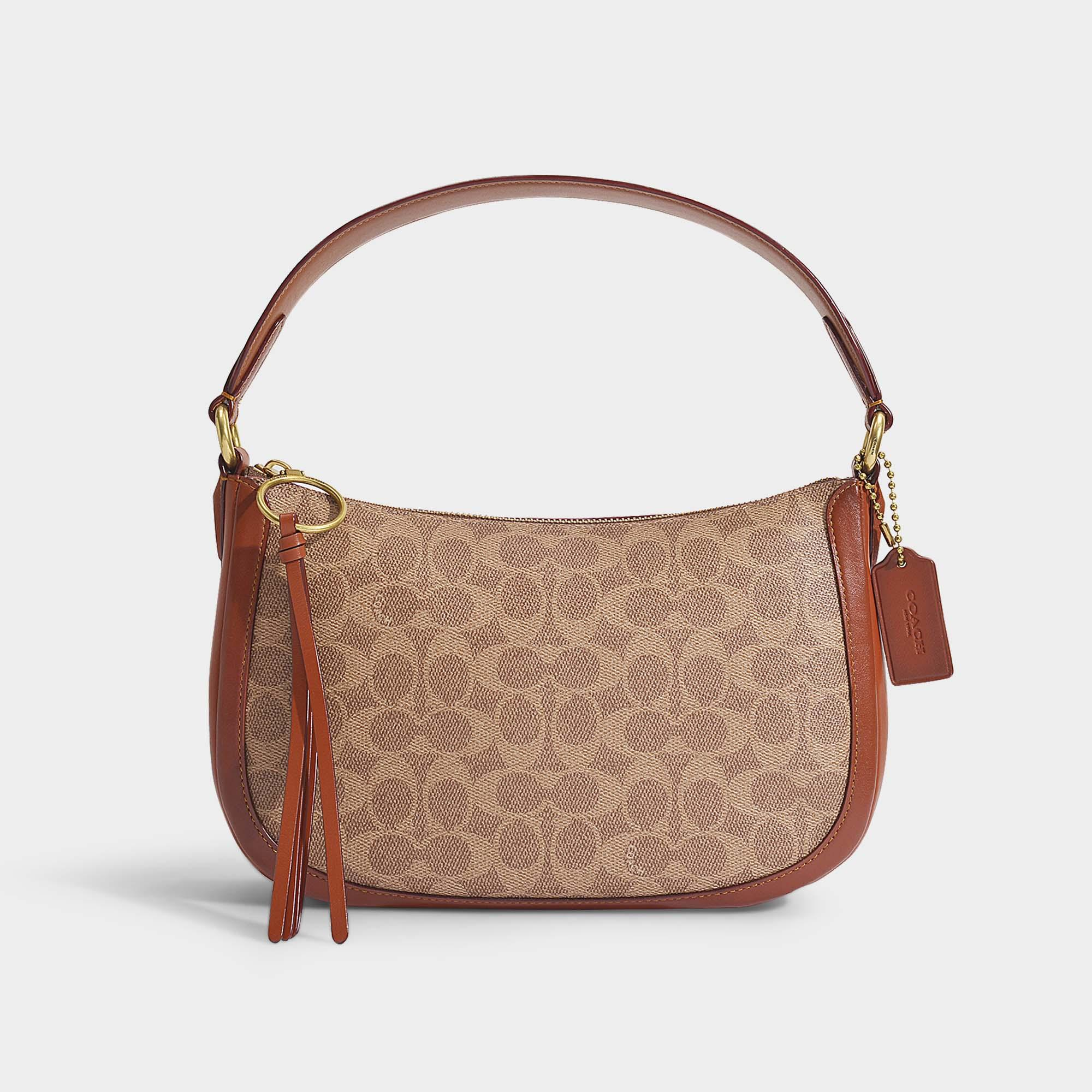 Signature Coated Canvas Sutton Crossbody Bag In Brown Pvc