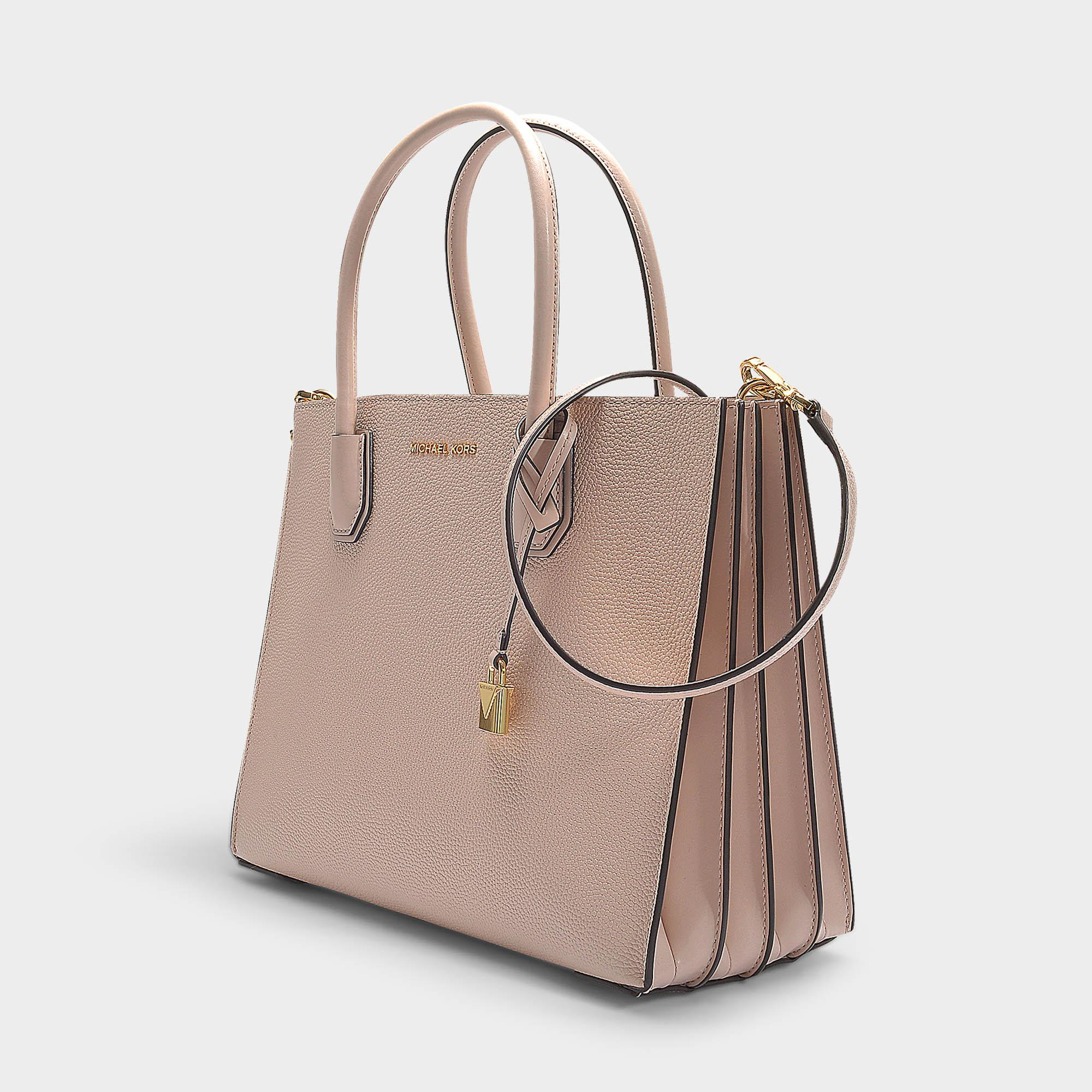 fabeb1a6ae537e MICHAEL Michael Kors - Mercer Large Accordion Convertible Tote Bag In Soft  Pink Grained Calfskin -. View fullscreen