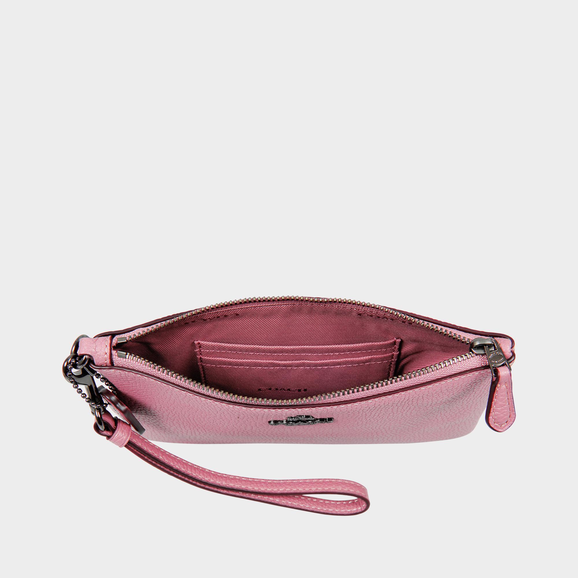 Petite pochette wrislet en cuir de veau rose