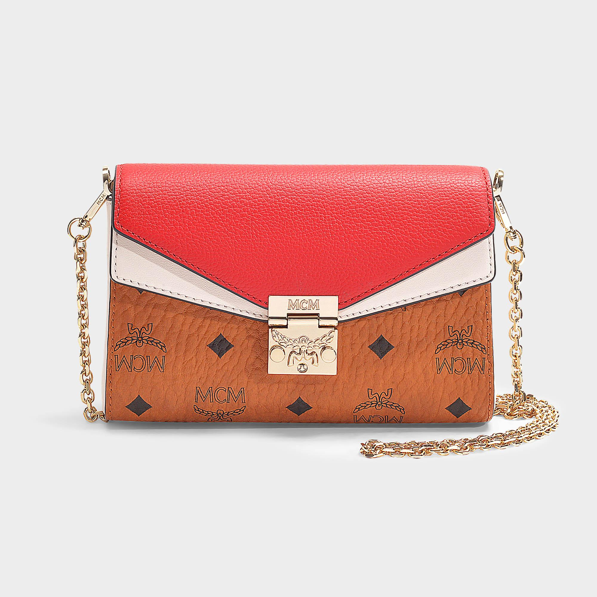 8d6bc47c5d56d MCM - Millie Visetos Leather Block Small Crossbody Bag In Cognac And Red  Coated Canvas -. View fullscreen