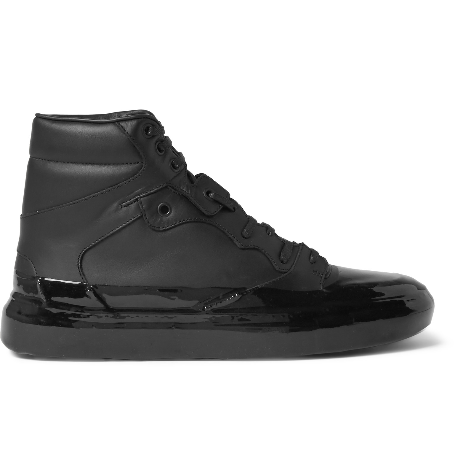 Cristóbal Balenciaga left an indelible mark upon fashion. BALENCIAGA, the Paris-based label he founded remains a consistently evolving label. The bold high top sneakers are one of the maison's immediate classics and prove that the fashion houses can do casual footwear just as well as the established sportswear giants.