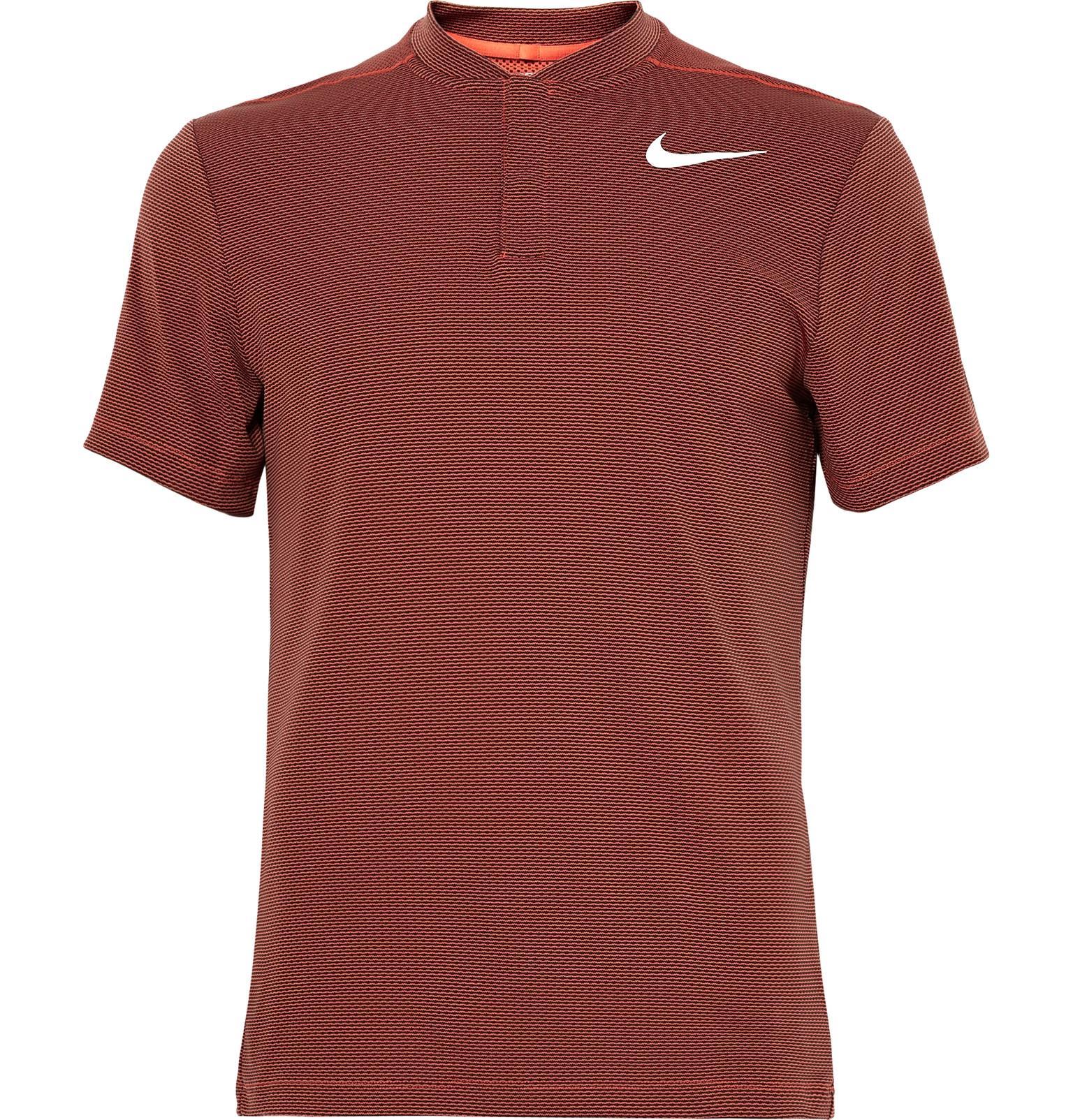 Lyst nike dri fit aeroreact polo shirt in orange for men for Dri fit polo shirts for boys