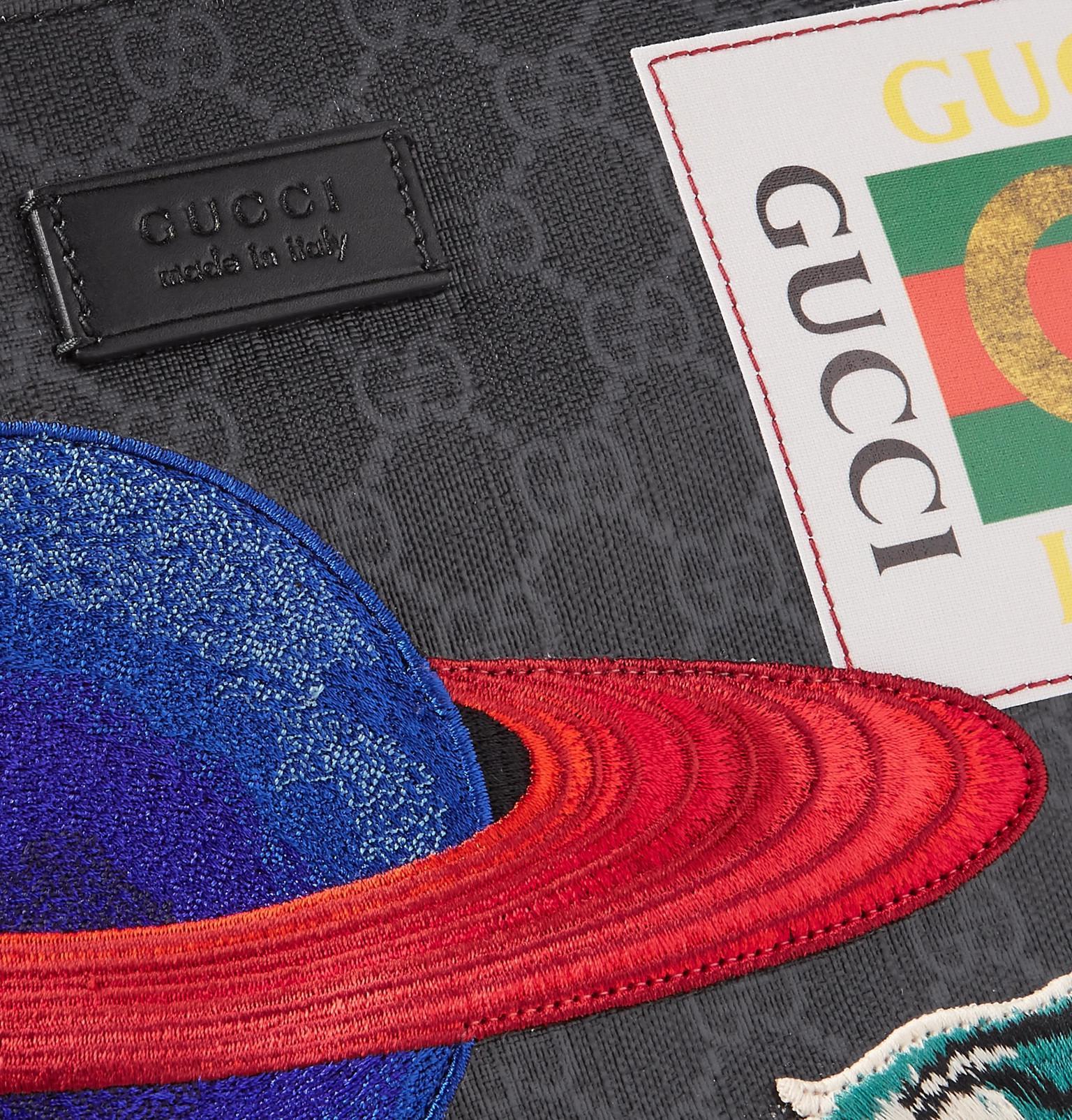 591d5e318a04b7 Gucci Courrier Leather-trimmed Appliquéd Monogrammed Coated-canvas ...