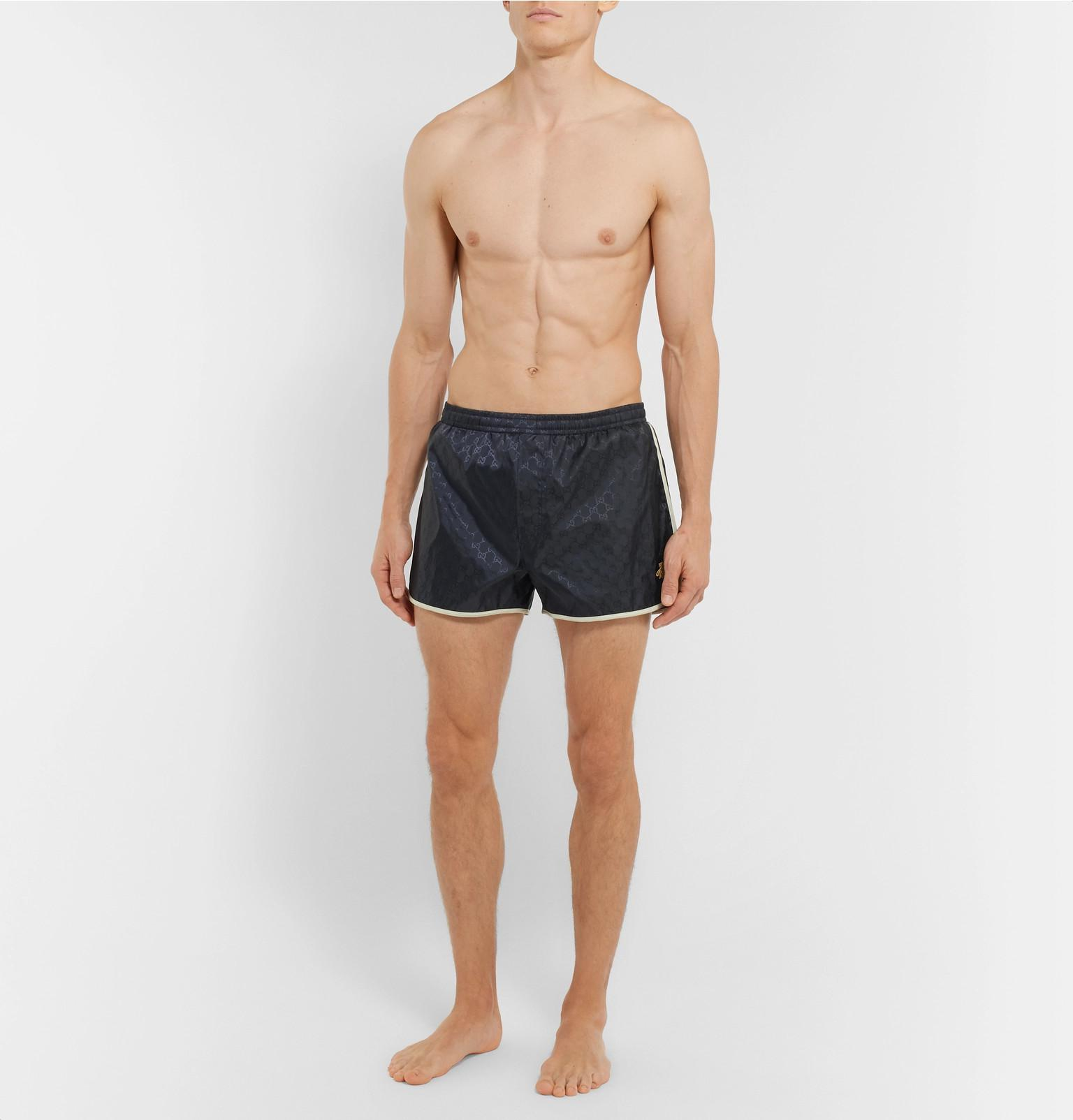 a05aa4551a Tap to visit site. Gucci - Blue Short-length Embroidered Jacquard Swim  Shorts for Men - Lyst